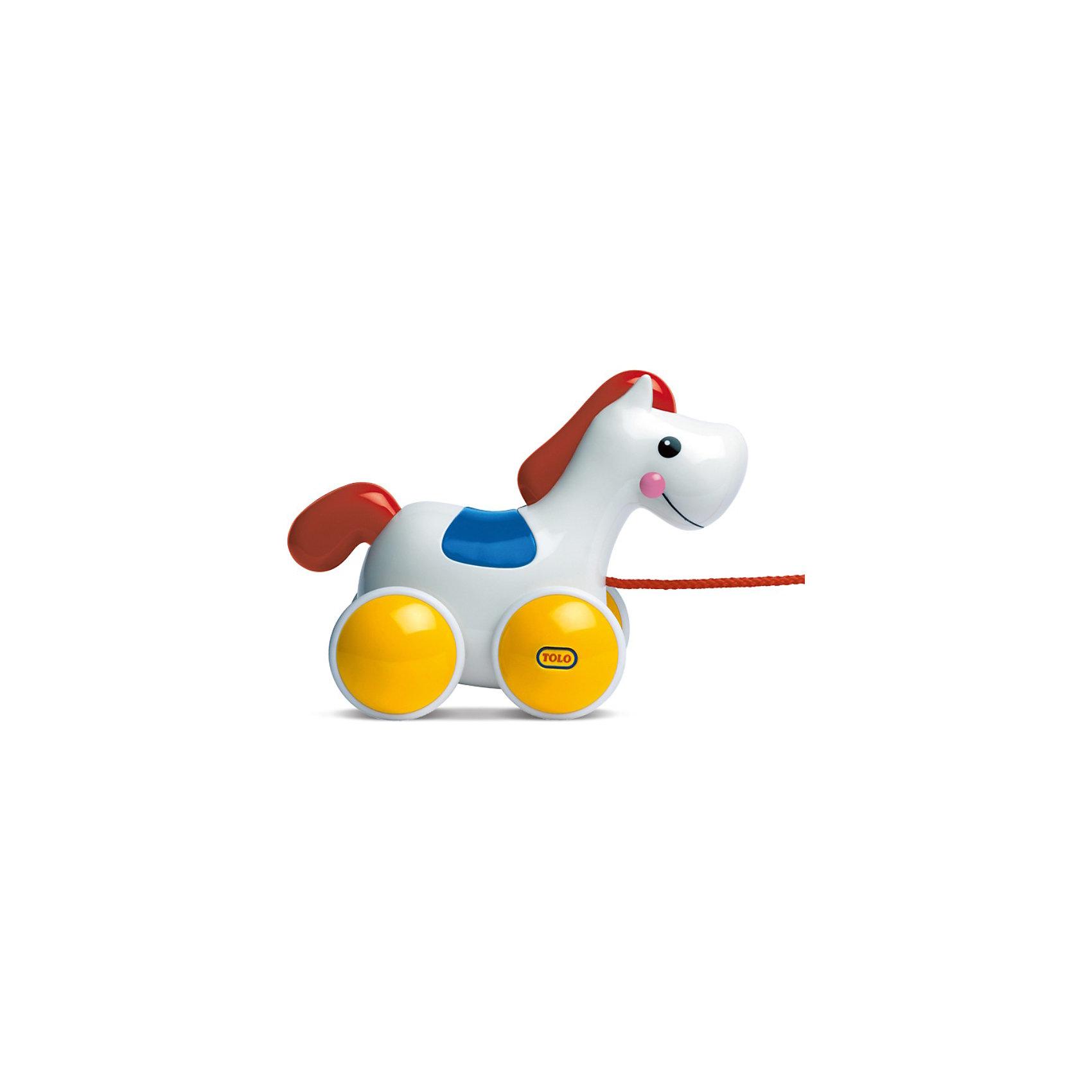 Игрушка Лошадка на колесах, TOLO CLASSICИгрушка Лошадка на колесах, TOLO CLASSIC (ТОЛО) - это разноцветная игрушка, с дружелюбной мордашкой. Лошадку можно возить на веревочке или катать ручками. Во время движения пони качает головой и цокает копытами.<br><br>Дополнительная информация:<br><br>- материал: пластмасса<br>- размеры упаковки: 31 х 17 х 18 см<br><br>Игрушку Лошадка на колесах, TOLO CLASSIC можно купить в нашем магазине.<br><br>Ширина мм: 310<br>Глубина мм: 168<br>Высота мм: 178<br>Вес г: 660<br>Возраст от месяцев: 12<br>Возраст до месяцев: 36<br>Пол: Унисекс<br>Возраст: Детский<br>SKU: 1440111
