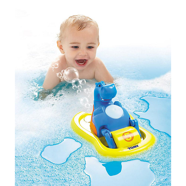 Игрушка для ванной «Бегемотик на катамаране», TOMYДинамические игрушки<br>Игрушка для ванной «Бегемотик на катамаране» из серии AQUA FUN известного бренда TOMY - это забавная игрушка для купания, которая подойдет и младенцам, и маленьким детям. <br><br>Малыш никогда не получал столько удовольствия от купания – великолепная игрушка в виде улыбающегося бегемотика на жёлтом катамаране развеселит каждого малыша во время водных процедур!<br><br>Инструкция совершенно проста. У игрушки есть специальное отверстие, куда нужно залить пену или мыльный раствор. Животик бегемота представлен в виде большой голубой кнопки. Нажав на неё, бегемотик начинает плавать в ванне на катамаране и даже напевать при этом задорнейшую песенку! Остановить его движение и музыкальное сопровождение можно также с помощью кнопки на животе бегемота. И это ещё не всё! Двигаясь по воде, из катамарана будут вылетать мыльные пузыри –  ну разве Ваш малыш останется равнодушным после этого?<br><br>Во время игры с бегемотиком, ваш ребёнок не только получает неописуемое удовольствие, но также непосредственно развивает важнейшие навыки. У малыша развивается моторика, логика и координация. <br><br>Никогда ещё купание Вашего малыша не было таким весёлым и полезным!<br><br>Дополнительная информация:<br>Материал: пластмасса<br>Размер (д/ш/в): 25 х 18,3 х 15,4 см<br>Вес: 0,52 кг<br>Батарейки: 3 щелочные батарейки Миньон типа LR06/AA (входят в комплект)<br><br>Рекомендуем сразу купить запасные батарейки - чтобы продлить удовольствие!<br>Ширина мм: 222; Глубина мм: 213; Высота мм: 134; Вес г: 527; Возраст от месяцев: 12; Возраст до месяцев: 48; Пол: Унисекс; Возраст: Детский; SKU: 1602936;