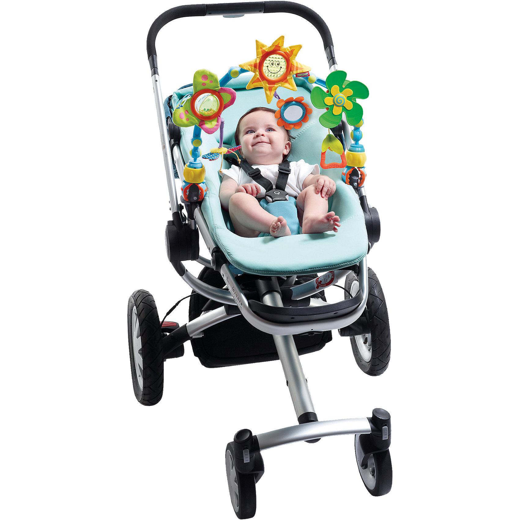 Дуга-трансформер Солнечная, Tiny LoveИгрушки для малышей<br>Развивающая дуга «Солнечная» фирмы Tiny Love (Тини Лав) - это неизменный спутник всех мобильных малышей. Она предлагает столько разнообразных возможностей для игр и развлечений, что малышу не успеет наскучить продолжительная прогулка в коляске или поездка в автомобильном кресле. <br>Дугу легко прикрепить практически к любой коляске, креслу или стульчику для кормления, а разноцветные фигурки - отбрасывающее солнечных зайчиков солнышко, бабочка и маленький пропеллер - позаботятся о том, чтобы малыш не заскучал. <br>Дуга собрана из эластичных деталей, и Вы сможете каждый раз менять её высоту и положение. Развивающая дуга «Солнечная» стимулирует развитие чувств, крупную и мелкую моторику и мировосприятие малыша.<br><br>Дополнительная информация:<br><br>- В комплекте:  большая бабочка — погремушка с шуршащими крылышками, маленькая бабочка, вертушка- пропеллер с бубенчиком, цветочек с зеркальцем.<br>- Размеры: 50х31х7 см<br><br>Дугу-трансформер Солнечная, Tiny Love (Тини Лав) можно купиь в нашем интернет магазине.<br><br>Ширина мм: 506<br>Глубина мм: 314<br>Высота мм: 78<br>Вес г: 658<br>Возраст от месяцев: 0<br>Возраст до месяцев: 12<br>Пол: Унисекс<br>Возраст: Детский<br>SKU: 1856283