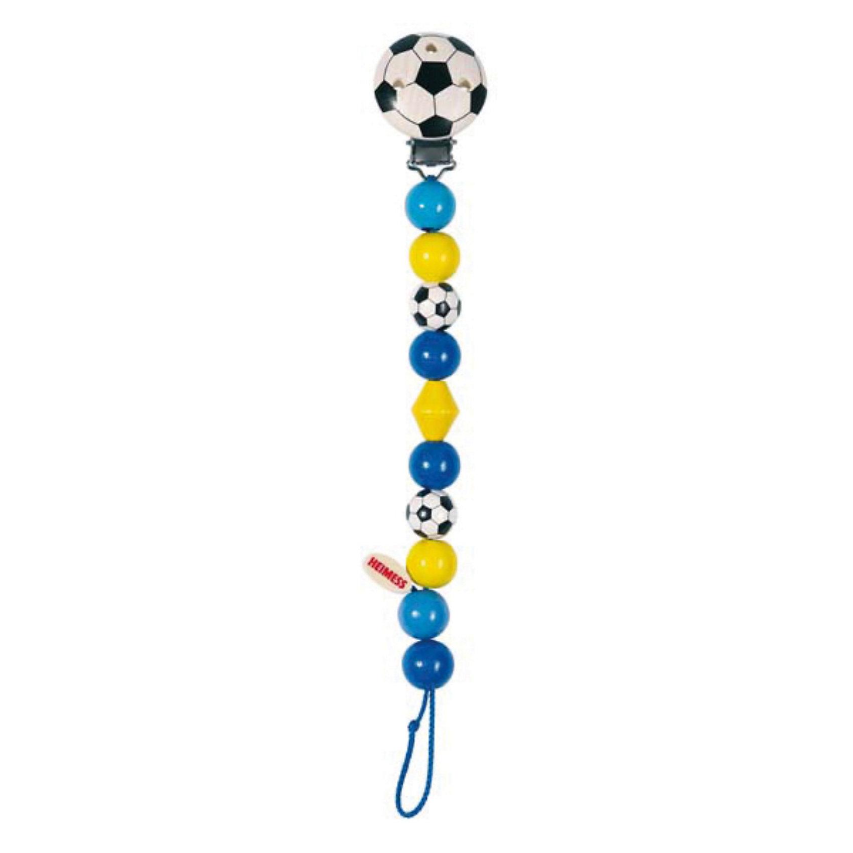 Держатель  с клипсой  Футбол, синий, HEIMESSДержатель  с клипсой  Футбол, синий, HEIMESS (ХАЙМЕСС) – это держатель для соски, который можно использовать как развивающую игрушку.<br>Деревянный держатель с клипсой Футбол от немецкого бренда Heimess (Хаймесс) не позволит пустышке случайно упасть. Его можно использовать с рождения. Яркий красивый держатель для соски состоит из разноцветных деревянных элементов в виде шариков, ромба и футбольных мячей. Держатель сделан из легкого дерева, прищепка - из металла. Металлическая прищепка закрыта деревянным кружочком в виде мяча, поэтому малыш не сможет пораниться об нее. Длина держателя рассчитана таким образом, чтобы он не стеснял движений малыша и не смог обвить шею ребенка. Пустышка крепится с помощью петельки. Можно использовать два вида сосок: имеющие колечки крепятся стандартно «петля в петлю», а соска без кольца затягивается в петлю с помощью деревянного язычка с надписью Heimess. Подросшему малышу держатель будет интересен как развивающая игрушка. Он с интересом будет перебирать элементы держателя, рассматривать их форму и цвет. Все детали очень гладкие и абсолютно безопасны для малыша. Держатель изготовлен из качественной древесины и покрыт стойкими безопасными красками на водной основе. Важной особенностью является поверхностная пропитка элементов держателя, что исключает возможность сколов и отслоений краски. HEIMESS (ХАЙМЕСС) - крупный немецкий производитель детских игрушек из дерева. Это игрушки с историей и традициями настоящего немецкого производства. Качество и безопасность этих игрушек доказаны, более чем 50 летним опытом. Вся продукция под брендом HEIMESS (ХАЙМЕСС) производится непосредственно в Германии.<br><br>Дополнительная информация:<br><br>- Материал: древесина, стойкие краски на водной основе<br>- Длина: 21 см.<br>- Цвет: синий, голубой, желтый, черный, белый<br>- Вес: 23 гр.<br><br>Держатель  с клипсой  Футбол, синий, HEIMESS (ХАЙМЕСС) можно купить в нашем интернет-магазине.<br><br>Ширина мм: 210<br>