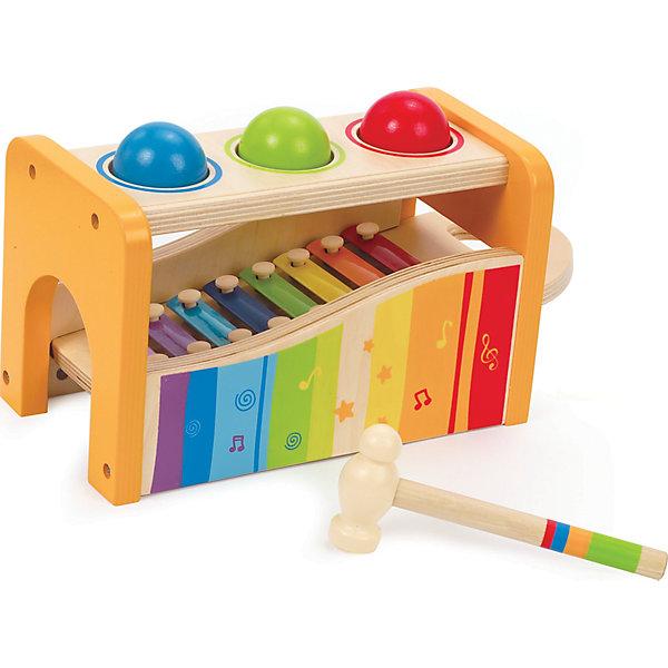 Игрушка деревянная Музыкальный набор, HapeКсилофоны<br>Игрушка деревянная Музыкальный набор, Hape - обязательно понравится малышу!<br><br>Играть можно двумя способами: бить молоточкам по шарикам, они будут падать внутрь и в сопровождении веселых звуков выкатываться из ворот; ксилофон можно использовать отдельно, для этого его необходимо вытащить из деревянного каркаса.  Ксилофон с разноцветными клавишами воспроизводит целую октаву звуков. Игрушка развивает навыки мелкой моторики, координацию движений, учит пониманию причины и следствия.<br><br>Дополнительная информация:<br><br>В набор входит: <br>- деревянный каркас, <br>- 3 разноцветные деревянные шарика, <br>- ксилофон с металлическими клавишами,<br>- молоточек.<br>Размер упаковки: 30 х 15 х 18 см<br>Размер игрушки: 24 х 15 х 13.5 см <br><br>Игрушку деревянную Музыкальный набор, Hape можно купить в нашем интернет - магазине.<br>Ширина мм: 307; Глубина мм: 182; Высота мм: 155; Вес г: 1340; Возраст от месяцев: 12; Возраст до месяцев: 36; Пол: Унисекс; Возраст: Детский; SKU: 2503719;