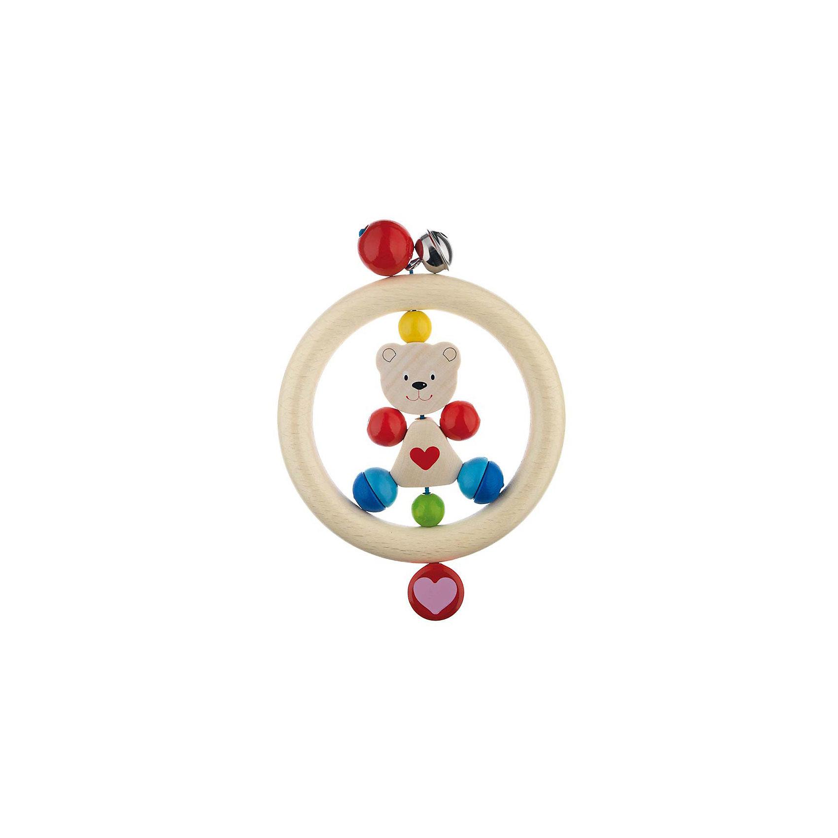 Игрушка-кольцо Медвежонок с сердцем, HEIMESSПодвески<br>Игрушка-кольцо Медвежонок с сердцем, HEIMESS (ХАЙМЕСС) - это качественная, красивая деревянная игрушка для малышей.<br>Игрушка-кольцо Медвежонок с сердцем от немецкого бренда HEIMESS (ХАЙМЕСС), наверняка, понравится Вашему малышу – эту игрушку так и хочется взять в руки! Игрушка состоит из деревянного кольца, внутри которого закреплена фигурка медвежонка и разноцветные элементы в виде шаров. Снаружи кольцо дополнено двумя разноцветными бусинами и колокольчиком. Игрушка изготовлена из качественной древесины и покрыта стойкими безопасными красками на водной основе. Благодаря этому ребенок может брать ее в рот. Каждый элемент игрушки хорошо отшлифован, поэтому он гладкий и без сколов. Игрушка-кольцо Медвежонок с сердцем развивает мелкую моторику рук, ведь малышу будет интересно осмотреть и ощупать маленькими пальчиками разноцветные элементы, услышать приятный звук колокольчика. Размер и конструкция игрушки замечательно подходит для маленьких детских ручек, а за деревянное кольцо очень удобно хвататься. Игрушки от Heimess (Хаймесс) уже больше 50 лет пользуются популярностью у детей и родителей. Они делаются из самых безопасных материалов и тщательно тестируются.<br><br>Дополнительная информация:<br><br>- Возраст: от 0 лет<br>- Материал: древесина, стойкие краски на водной основе<br>- Диаметр: 14 см.<br><br>Игрушку-кольцо Медвежонок с сердцем, HEIMESS (ХАЙМЕСС) можно купить в нашем интернет-магазине.<br><br>Ширина мм: 140<br>Глубина мм: 140<br>Высота мм: 30<br>Вес г: 50<br>Возраст от месяцев: 0<br>Возраст до месяцев: 12<br>Пол: Унисекс<br>Возраст: Детский<br>SKU: 3321626