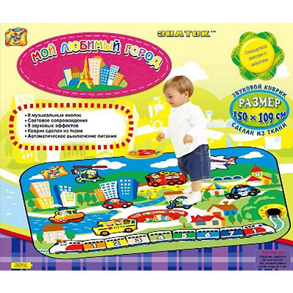 Звуковой коврик «Мой любимый город»Интерактивные игрушки для малышей<br>Мы рады представить вашему вниманию новый звуковой коврик «Мой любимый город», сделанный из ткани. Коврик легко складывается и удобен при переноске и хранении. Дети легко обучаются обращению с ним. Данное изделие призвано не только доставить детям удовольствие, но также способствует их развитию. Изделие представляет собой звуковой коврик, способный воспроизводить реалистичные звуки, соответствующие изображениям. Звуки сопровождаются свечением лампочки на консоли. Цифры, написанные на вагончиках, соответствуют нотам: 1 - До, 2 - Ре, 3 - Ми, 4 - Фа, 5 - Соль, 6 - Ля, 7 - Си, i – До (из другой октавы). Можно воспроизвести разные мелодии, например, «Жили у бабуси два весёлых гуся» - 4321/55/4321/55//4664/3553/2342/11 или «Чижик-пыжик» - 3131/432/ 55567/111. Выключатель находится на пластиковой консоли.<br><br>Ширина мм: 660<br>Глубина мм: 560<br>Высота мм: 50<br>Вес г: 400<br>Возраст от месяцев: 36<br>Возраст до месяцев: 96<br>Пол: Унисекс<br>Возраст: Детский<br>SKU: 3341079