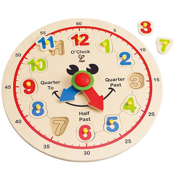 Игрушка деревянная Счастливые часы, HapeДеревянные игрушки<br>Игрушка деревянная Счастливые часы от Hape - обязательно понравится малышу! С помощью этих добродушно улыбающихся часиков ребенок сможет выучить цифры и научиться распознавать время.<br> На циферблате изображены часы и секунды, стрелки легко двигаются. Родители могут играть вместе с ребенком, одновременно обучая его: необходимо перевернуть игрушку, высыпать и перемешать цифры, теперь малышу предстоит самостоятельно разместить их на циферблате в правильном порядке. <br> Все фигурки вырезаны вручную, а картинки нанесены непосредственно на деревянное основание, что говорит о высоком качестве изделия.<br><br>Дополнительно:<br>Размер упаковки: 29 х 29 см<br>Размер игрушки: 30 х 3,6 см <br><br>Игрушка деревянная Счастливые часы, Hape - можно купить в нашем интернет - магазине.<br><br>Ширина мм: 300<br>Глубина мм: 35<br>Высота мм: 300<br>Вес г: 5800<br>Возраст от месяцев: 36<br>Возраст до месяцев: 72<br>Пол: Унисекс<br>Возраст: Детский<br>SKU: 3357931