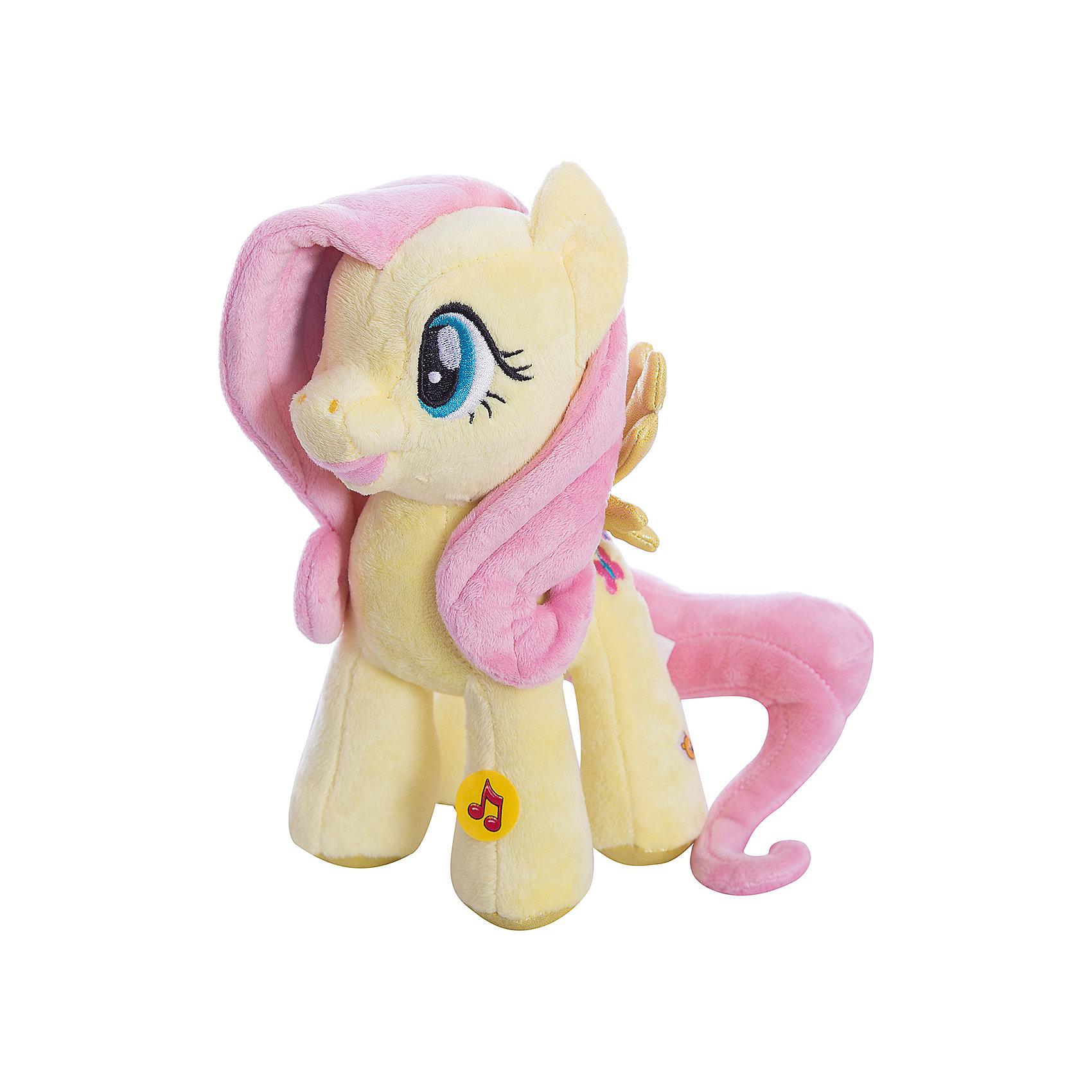 Мягкая игрушка  Пони Флаттершай, со светом и звуком, My little Pony, МУЛЬТИ-ПУЛЬТИОзвученные мягкие игрушки<br>Мягкая игрушка Мульти-Пульти пони из мультсериала My Little Pony станет замечательным подарком для Вашей девочки. Пони Флаттершай из волшебного королевства очень красива, у нее розовая грива и хвост, игрушка очень мягкая и приятная на ощупь. Если нажать ей на ножку, то она заговорит или будет петь песню из мультика, игрушка также обладает световым эффектом. <br><br>Дополнительная информация:<br><br>- Материал: текстиль, синтепон.<br>- Требуются батарейки: 3* LR44 (входят в комплект).<br>- Высота игрушки: 23 см.<br>- Размер упаковки: 23 x 17 x 8 см<br>- Вес: 0.23 кг.<br><br>Мягкую игрушку Пони Флаттершай My little Pony от Мульти-Пульти можно купить в нашем магазине.<br><br>Ширина мм: 130<br>Глубина мм: 230<br>Высота мм: 340<br>Вес г: 109<br>Возраст от месяцев: 24<br>Возраст до месяцев: 1188<br>Пол: Унисекс<br>Возраст: Детский<br>SKU: 3384136