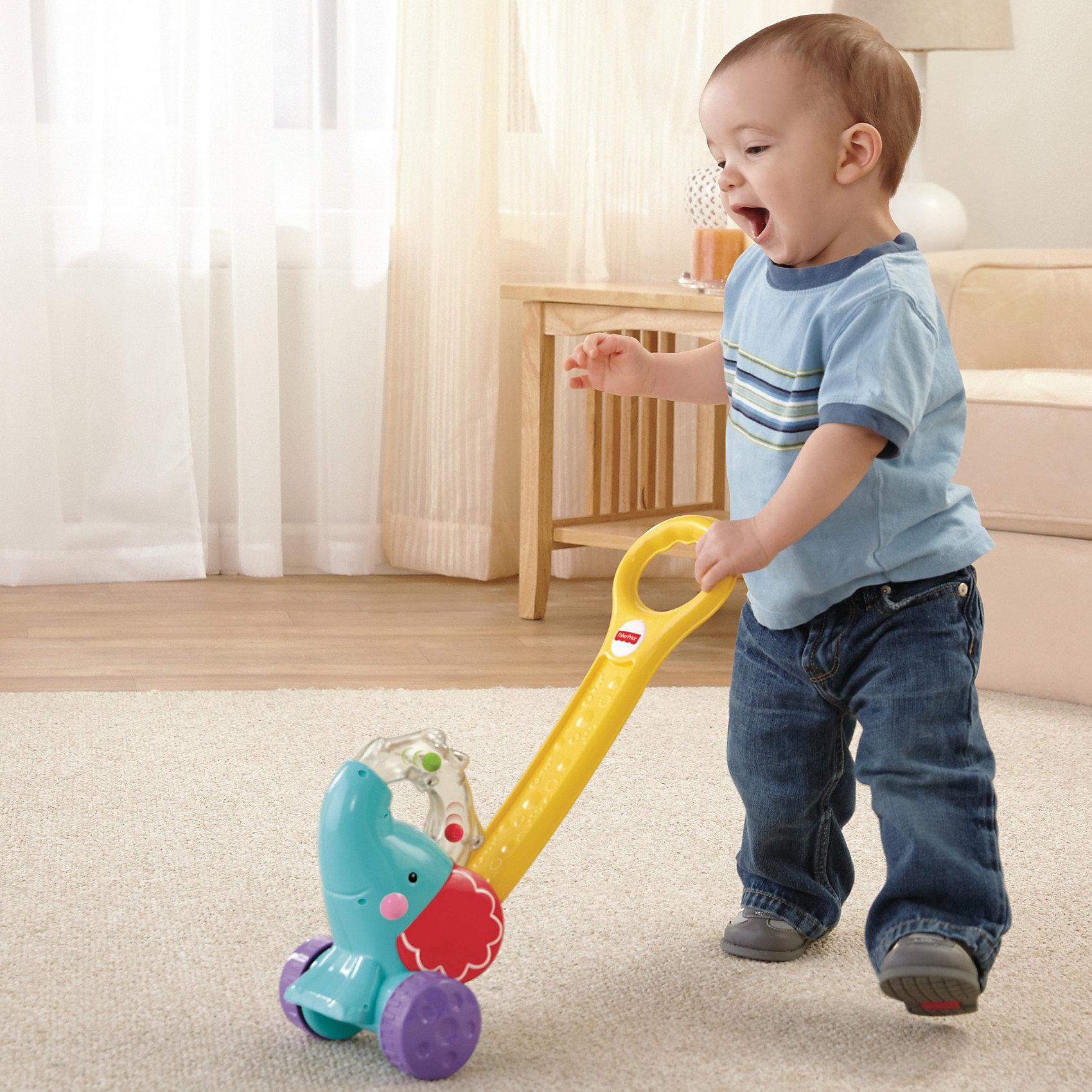 Игрушка-каталка Слоник, Fisher-priceИгрушки-каталки<br>Игрушка-каталка Слоник, Fisher-price (Фишер-Прайс) это красочная развивающих игрушка, которая обязательно привлечет внимание Вашего малыша. Каталка выполнена в виде забавного<br>красочного слоненка с сюрпризом: когда малыш толкает слоненка вперед, из его прозрачного хобота начинают выпрыгивать цветные шарики, это продолжается все время, пока слоненок находится в движении. Подталкивает игрушку за удобную ручку малыш развивает навык поддержания равновесия и координацию движений. В комплект входят 3 ярких шарика.<br><br>Дополнительная информация:<br><br>- Материал: пластик.<br>- Высота ручки-толкателя: 45 см.<br>- Размер упаковки: 29 х 14 х 36 см.<br>- Вес: 2 кг. <br><br>Игрушка способствует развитию двигательной активности, звукового и цветового восприятия, координации движений и мелкой моторики рук.<br><br>Игрушку-каталку Слоник, Fisher-price можно купить в нашем интернет-магазине.<br><br>Ширина мм: 359<br>Глубина мм: 294<br>Высота мм: 144<br>Вес г: 698<br>Возраст от месяцев: 12<br>Возраст до месяцев: 36<br>Пол: Унисекс<br>Возраст: Детский<br>SKU: 3399170
