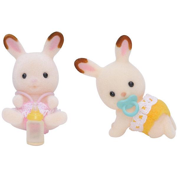 Набор Шоколадные Кролики-двойняшки (новая версия), Sylvanian FamiliesSylvanian Families<br>Набор Шоколадные Кролики-двойняшки (новая версия), Sylvanian Families (Сильваниан Фэмилис) - прекрасный набор, состоящий из двух маленьких кроликов. Сестренка в розовом платьице и ее братик, в желтых штанишках, -  озорные непоседы- двойняшки, которые любят играть и веселиться вместе.  В комплект к фигуркам входят маленькая бутылочка и пустышка. Все детали игрушек отлично проработаны и выполнены из высококачественного материала. Этот набор прекрасно развивает мелкую моторику и фантазию ребенка.<br><br>Дополнительная информация:<br><br>- Материал: пластик,  ПВХ с полимерным напылением, текстиль<br>- Размер: 3.5 см<br>- Комплектация: две фигурки, бутылочка, пустышка.<br>- Подвижные головы у фигурок<br><br>Набор Шоколадные Кролики-двойняшки (новая версия), Sylvanian Families (Сильваниан Фэмилис) можно купить в нашем магазине.<br><br>Ширина мм: 123<br>Глубина мм: 83<br>Высота мм: 38<br>Вес г: 39<br>Возраст от месяцев: 36<br>Возраст до месяцев: 72<br>Пол: Женский<br>Возраст: Детский<br>SKU: 3549188