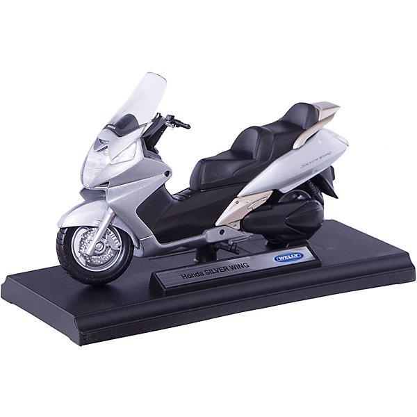 Модель мотоцикла 1:18  Honda Silver Wing , WellyМашинки<br>Модель мотоцикла 1:18  Honda Silver Wing , Welly (Велли) - точная копия настоящего максискутера Honda Silver Wing выполненная в масштабе 1:18 c высокой степенью детализации. Игрушка выполнена из прочного металла с пластиковыми элементами. Корпус изготовлен литьевым способом, что обеспечивает высокую прочность и долговечность в использовании, а также максимальную похожесть на оригинал.<br><br>С моделью мотоцикла 1:18  Honda Silver Wing , Welly  можно не только играть, но и сделать его частью своей коллекции!<br><br>Дополнительная информация:<br><br>- Размер: 17 х 7 х 11 см<br>- Материал: металл, пластик<br>- Вес: 180 г.<br><br>Модель мотоцикла 1:18  Honda Silver Wing , Welly (Велли) можно купить в нашем интернет-магазине.<br><br>Ширина мм: 170<br>Глубина мм: 70<br>Высота мм: 110<br>Вес г: 180<br>Возраст от месяцев: 36<br>Возраст до месяцев: 192<br>Пол: Мужской<br>Возраст: Детский<br>SKU: 3593303