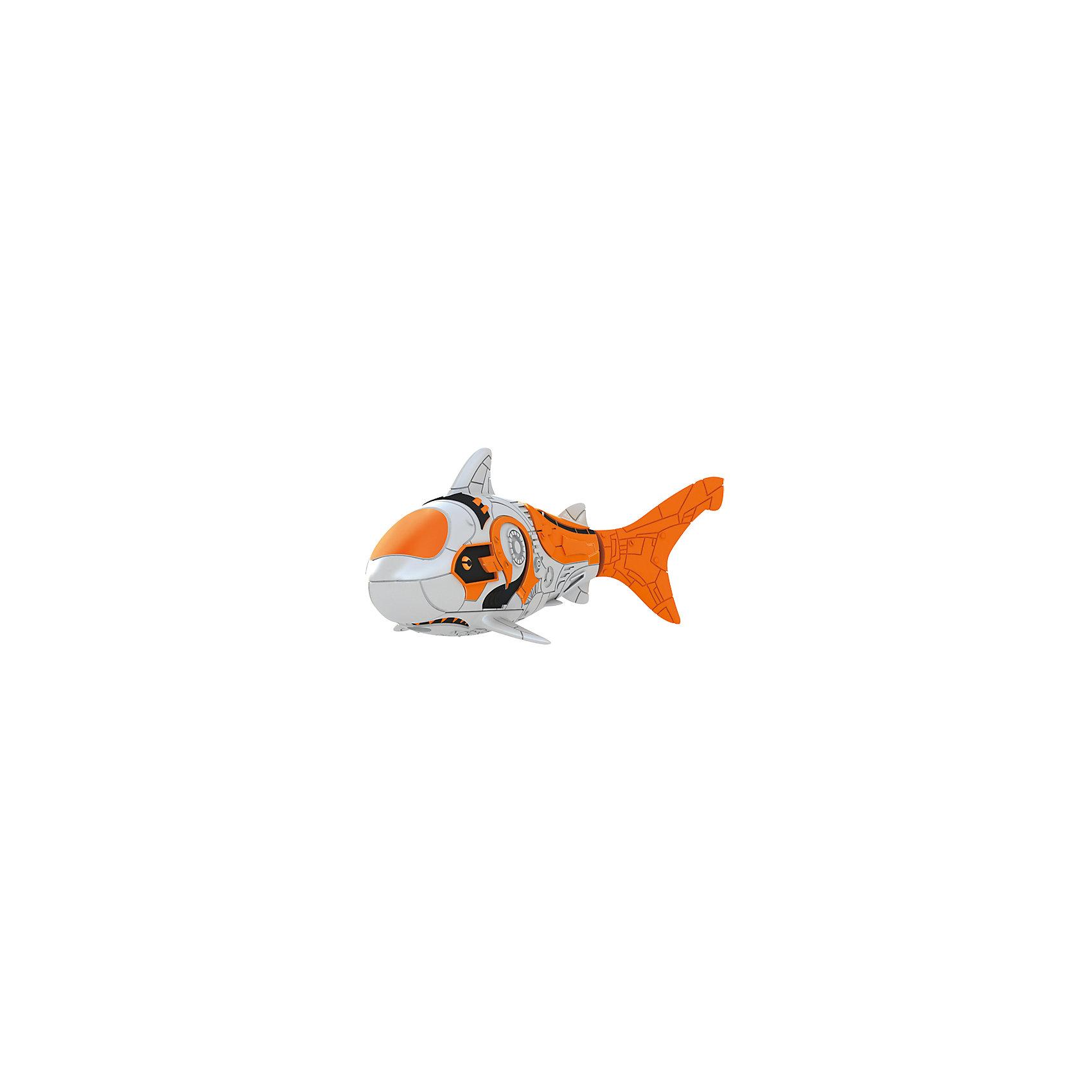 РобоРыбка Акула, RoboFishРоборыбки и русалки<br>Тропическая РобоРыбка Акула, ZURU (Зуру) – это высокотехнологичная инновационная игрушка, имитирующая движения и повадки рыбы в воде.<br>Тропическая РобоРыбка Акула выглядит как настоящая и двигается словно живая! Для РобоРыбки нужна только ёмкость с водой, и никакого ухода! Автоматический датчик, активирует рыбку в воде. Мягкий силиконовый хвост и электромагнитный мотор позволит ей двигаться в 5 различных направлениях: влево, вправо, вперед, вверх или вниз. Ультразвуковая герметизация на 100% защитит внутренности от проникновения воды. РобоРыбка повторяет повадки настоящих рыб: опускается на дно и всплывает на поверхность, сбивается в стаи с другими роборыбками, трется о стенки аквариума, меняет скорость движения, оплывает преграды. Внутри рыбки в крышке под батарейками находится специальный грузик, регулирующий глубину ее погружения. Для того, чтобы рыбка перестала двигаться нужно достать её из воды и насухо вытереть. Хранить РобоРыбку можно на специальной подставке, которая есть в комплекте. Игрушка выполнена из материалов абсолютно безопасных для здоровья.<br><br>Дополнительная информация:<br><br>- Возраст: для детей от 3 лет<br>- В комплекте: 1 рыбка, подставка, 4 батарейки (две установлены в игрушку и 2 запасные)<br>- Батарейки: тип RL44(A76)<br>- Размер рыбки: 7,5 x 2,0 x 3,5 см.<br>- Материал: пластик с элементами металла и резины<br>- Вес в упаковке: 72 г.<br>- Размер упаковки: 20 x 6,5 x 5 см.<br><br>Тропическая РобоРыбка Акула, ZURU (Зуру) - заведите себе аквариум, обитатели которого порадуют и развлекут Вас своими забавными повадками и при этом совсем не потребуют никакого ухода!<br><br>Тропическую РобоРыбку Акула, ZURU (Зуру) можно купить в нашем интернет-магазине.<br><br>Ширина мм: 435<br>Глубина мм: 240<br>Высота мм: 405<br>Вес г: 217<br>Возраст от месяцев: 48<br>Возраст до месяцев: 96<br>Пол: Унисекс<br>Возраст: Детский<br>SKU: 3609993