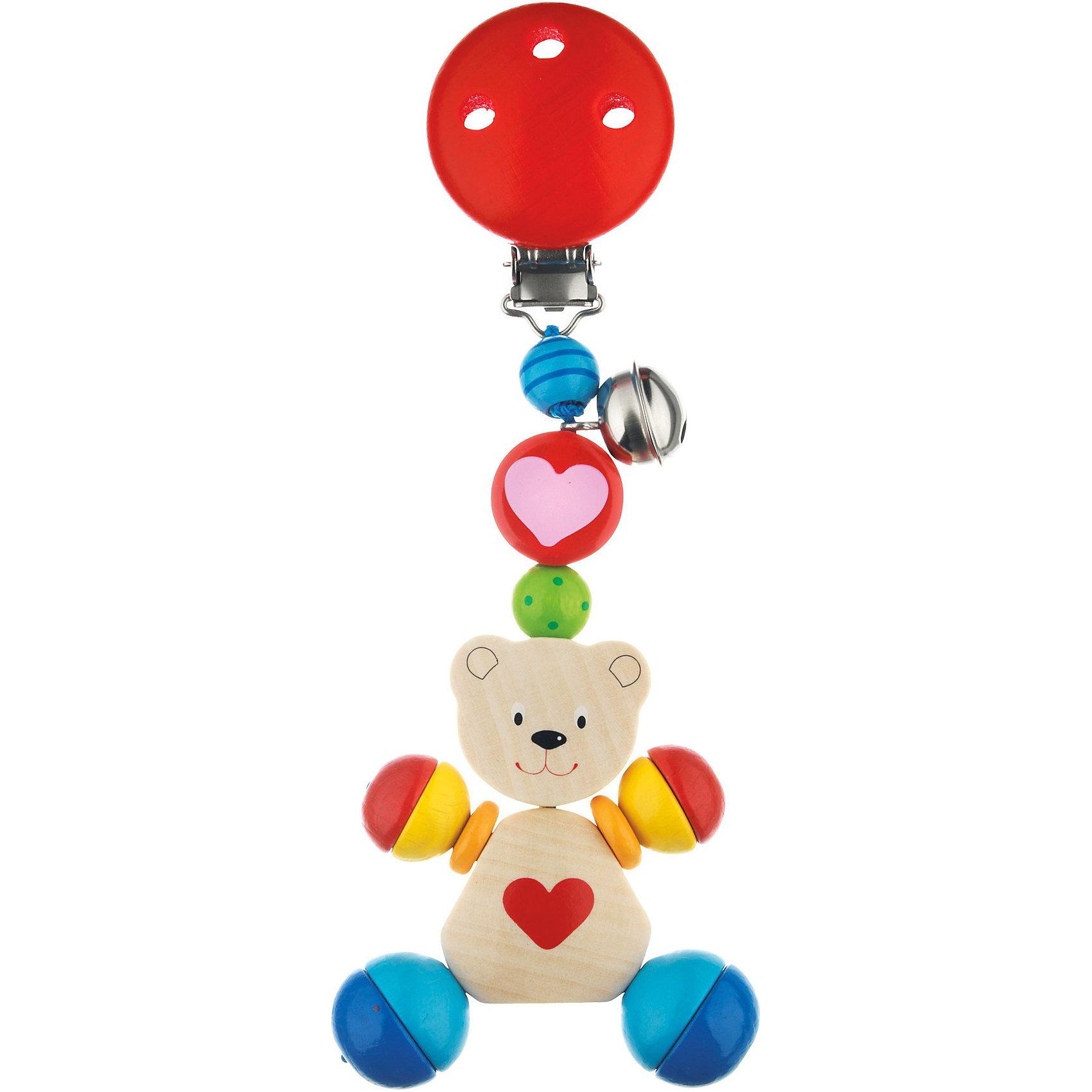Клипса с игрушкой Медвежонок с сердцем, HEIMESSПодвески<br>Клипса с игрушкой Медвежонок с сердцем, HEIMESS (ХАЙМЕСС) – это качественная, красивая деревянная игрушка-подвеска с безопасной клипсой.<br>Клипса с игрушкой Медвежонок с сердцем от немецкого бренда HEIMESS (ХАЙМЕСС) наверняка, понравится Вашему малышу. На прочном шнурке расположился чудесный мишка, сделанный из идеально гладких деревянных деталей разной формы, которые очень приятно перебирать в руках. При движении игрушка издает приятный звук благодаря маленькому бубенчику, который будет побуждать Вашего малыша тянуться к игрушке снова и снова. Металлическая клипса надежно и бережно прикрепит игрушку к одежде малыша или коляске и не поранит его благодаря защитному деревянному колпачку. Возьмите забавного медвежонка с собой на прогулку: он никогда не потеряется, и будет радовать малыша приятным звоном. Игрушка Медвежонок с сердцем будет день за днем развивать у малыша мелкую моторику, координацию движений и внимание. Она изготовлена из качественной древесины и покрыта стойкими безопасными красками на водной основе. Благодаря этому ребенок может брать игрушку в рот. Размер и конструкция игрушки замечательно подходит для маленьких детских ручек. Игрушки от Heimess (Хаймесс) уже больше 50 лет пользуются популярностью у детей и родителей. Они делаются из самых безопасных материалов и тщательно тестируются.<br><br>Дополнительная информация:<br><br>- Материал: древесина, стойкие краски на водной основе<br>- Размер: 11,5 см.<br>- Вес: 55 гр.<br><br>Клипсу с игрушкой Медвежонок с сердцем, HEIMESS (ХАЙМЕСС) можно купить в нашем интернет-магазине.<br><br>Ширина мм: 115<br>Глубина мм: 115<br>Высота мм: 115<br>Вес г: 55<br>Возраст от месяцев: 0<br>Возраст до месяцев: 24<br>Пол: Унисекс<br>Возраст: Детский<br>SKU: 3777825