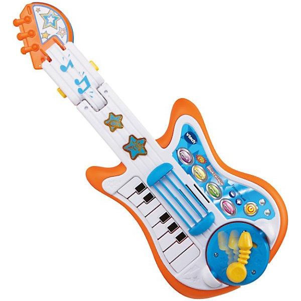 Развивающая игрушка Моя гитара, VtechГитары<br>Развивающая игрушка Моя гитара, Vtech (Втеч).<br><br>Характеристики:<br><br>• Для детей от 3 до 6 лет<br>• Материал: пластик<br>• 13 песен и мелодий из мультфильмов<br>• Батарейки: 3 типа АА (в комплекте демонстрационные)<br>• Упаковка: красочная подарочная коробка<br>• Размер упаковки: 56х28х8 см.<br><br>Развивающая игрушка Моя гитара от французской компании Vtech – замечательная музыкальная игрушка 3 в 1 для юных меломанов. Игрушка совмещает в себе сразу 3 музыкальных инструмента: гитару, пианино, барабан с тарелкой. Ваш ребенок сможет фантазировать целыми днями с этим удивительным музыкальным инструментом. Малыш может наигрывать в такт песням из знаменитых мультфильмов или же придумать свою собственную мелодию. <br><br>Переключаясь с гитары на барабан, пианино или тарелку, ребенок сможет самостоятельно создать настоящее музыкальное произведение. Удобный ремень, расположенный на гитаре, позволит играть стоя и пританцовывать. Световые эффекты, кнопка аплодисментов и эффекты тремоло помогут малышу создать настоящий домашний концерт с овациями. На игрушке есть кнопка включения, кнопки увеличения и уменьшения громкости, а также 4 кнопки с мелодиями. <br><br>Панель со струнами подвижная. На грифе расположены светящиеся звуковые кнопки в форме звёздочек. У гитары есть круглая вставка с гитарным рычажком, с обратной стороны которой находится барабан. Гитарный гриф можно трансформировать в барабанную тарелку. У встроенного пианино 13 клавиш. Предусмотрен таймер автоматического отключения. Игрушка изготовлена из прочного безопасного пластика. Продается в красочной коробке и идеально подходит в качестве подарка.<br><br>Развивающую игрушку Моя гитара, Vtech (Втеч) можно купить в нашем интернет-магазине.<br><br>Ширина мм: 280<br>Глубина мм: 80<br>Высота мм: 560<br>Вес г: 1280<br>Возраст от месяцев: 12<br>Возраст до месяцев: 48<br>Пол: Унисекс<br>Возраст: Детский<br>SKU: 3848613