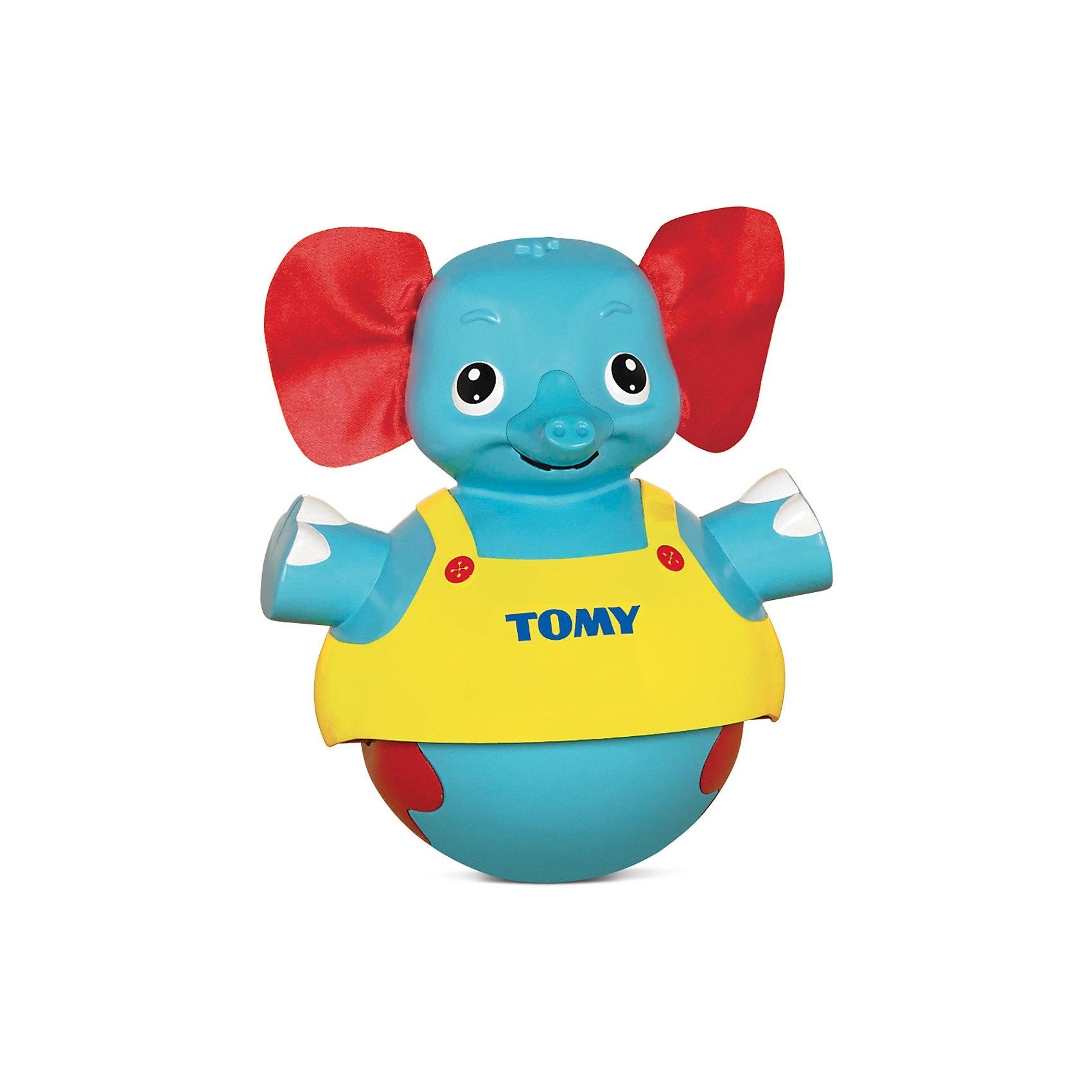Неваляшка Слоник учится ходить, TOMYНеваляшки<br>Классическая игрушка - неваляшка, знакомая всем с детства, в новом ярком исполнении. Слоник имеет ушки из ткани, сам выполнен из гипоаллергенного пластика, безопасного для детей. Этот милый слоненок подходит для детей разного возраста. Если ваш кроха еще не умеет самостоятельно передвигаться, он может просто наблюдать за слоником и слушать веселую мелодию. Если малыш уже может самостоятельно ползать или ходить, можно поставить слоника рядом с ним, нажать на голову - игрушка будет двигаться вперед и исполнять мелодию, стимулируя ребенка идти или ползти за ней. <br><br>Дополнительная информация:<br><br>- Материал: пластик, текстиль.<br>- Высота: 19 см.<br>- Цвет: желтый, красный, голубой.<br>- Звуковые эффекты: есть.<br>- Элемент питания: 3 батарейки ААА( в комплекте).<br><br>Игрушку Слоник учится ходить, TOMY (Томи) можно купить в нашем магазине.<br><br>Ширина мм: 210<br>Глубина мм: 150<br>Высота мм: 210<br>Вес г: 977<br>Возраст от месяцев: 10<br>Возраст до месяцев: 36<br>Пол: Унисекс<br>Возраст: Детский<br>SKU: 3922277