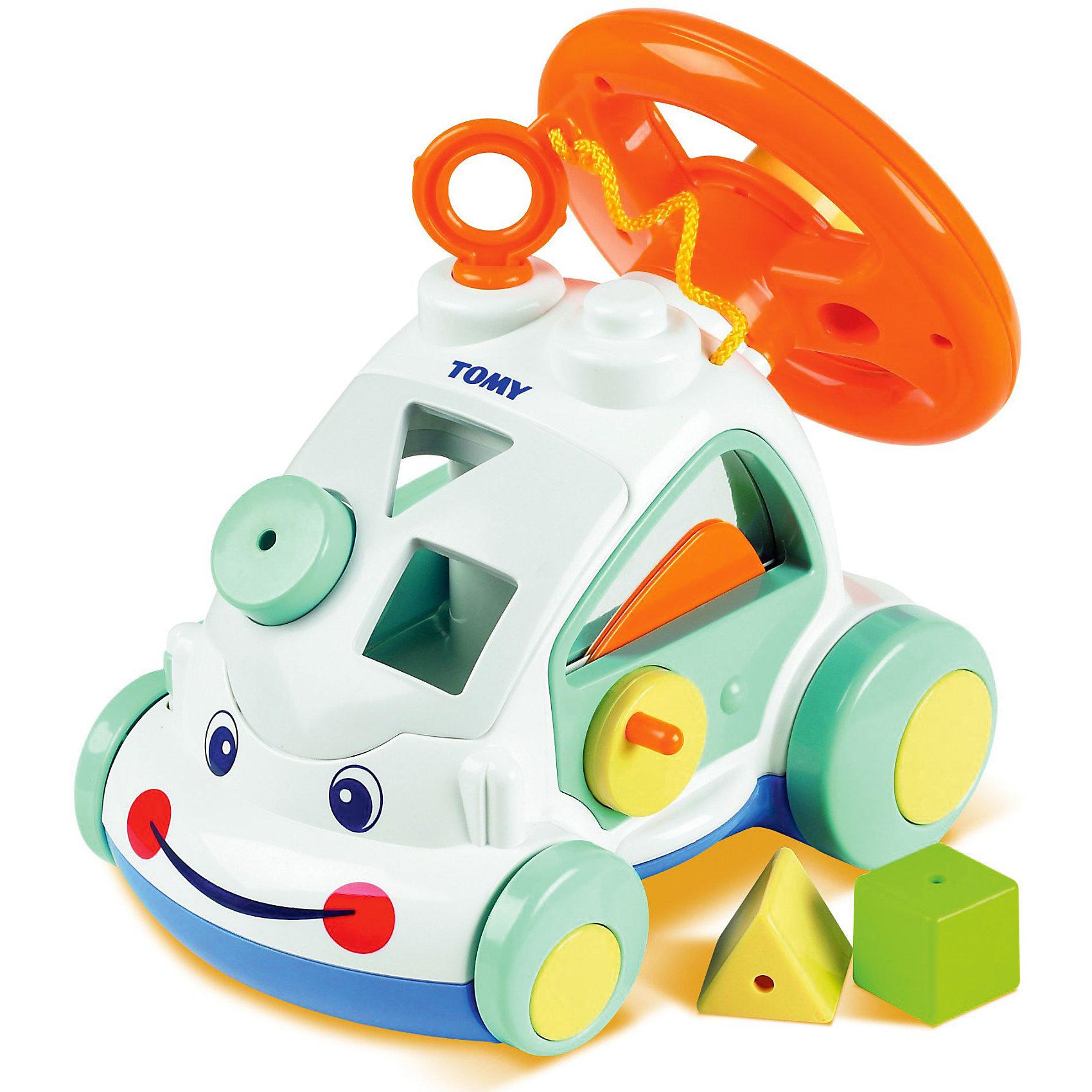 Интерактивный автомобиль, TOMYИнтерактивные игрушки для малышей<br>Интерактивный автомобиль, Tomy (Томи) - красочная развивающая игрушка, которая наверняка понравится Вашему ребенку. У машинки забавная улыбающаяся мордашка, в корпусе, который можно использовать как сортер, имеются фигурные прорези для разноцветных формочек (входят в комплект). При движении колеса издают характерный звук трещотки.<br>Сзади расположен большой крутящийся руль с крупной кнопкой-клаксоном, нажав на нее малыш услышит автомобильный гудок, а поворот руля будет сопровождаться веселым потрескиванием. Правая дверца машинки открывается с помощью ручки, а на левой дверке снаружи есть рычажок, который имитирует опускание бокового стекла. Автомобиль округлой формы с крупными деталями, малышу будет удобно хватать его и катать по полу. Игрушка способствует развитию логики, мелкой моторики и координации движений.<br><br>Дополнительная информация:<br><br>-Материал: пластмасса.<br>-Размер упаковки: 28 х 17 х 24 см.<br>-Вес: 1 кг.<br><br>Интерактивный автомобиль, Tomy (Томи), можно купить в нашем интернет-магазине.<br><br>Ширина мм: 280<br>Глубина мм: 170<br>Высота мм: 240<br>Вес г: 1000<br>Возраст от месяцев: 12<br>Возраст до месяцев: 36<br>Пол: Унисекс<br>Возраст: Детский<br>SKU: 3950203