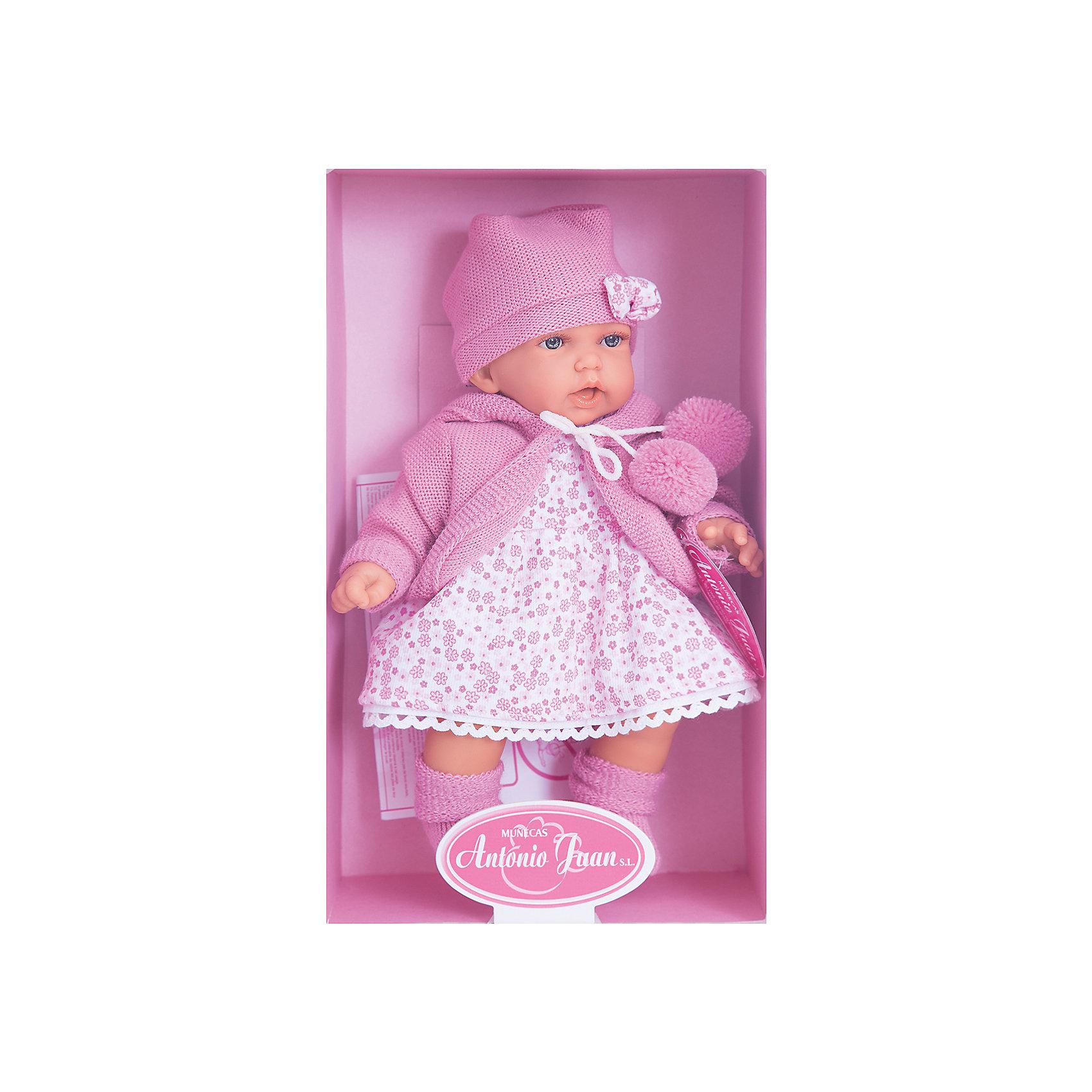 Кукла Азалия в ярко-розовом, 27 см, Munecas Antonio JuanКлассические куклы<br>Очаровательная малышка Азалия, Munecas Antonio Juan (Мунекас Антонио Хуан), покорит не только детей но даже их родителей. Куколка выглядит как настоящая маленькая девочка, а ее трогательный внешний вид вызывает только самые положительные и добрые эмоции. Все куклы Антонио Мунекас производятся в Испании в маленьком городе Аликанте и отличаются высоким качеством и потрясающим сходством с настоящими младенцами. В коллекции представлены куклы разных возрастов, как новорожденных так и детей постарше. Все детали тщательно проработаны, пропорции идентичны строению маленького ребенка. В создании кукол и одежды для них принимали участие известные европейские дизайнеры, поэтому каждая куколка имеет свой неповторимый индивидуальный образ и чудесный модный наряд, сшитый вручную.<br><br>У куклы Азалии милое детское личико и мягкие темные волосы, за которыми приятно ухаживать и расчесывать. Искусно выполненные детали, такие как складочки на ручках и ножках, пушистые реснички, пухлые щечки и губки, придают игрушке трогательный и реалистичный вид. Туловище куклы мягконабивное и маленькая хозяйка будет с удовольствием обнимать и тискать ее. Если нажать кукле на животик один раз - она засмеется, второй раз - скажет мама, третий раз - скажет папа. У Азалии подвижные ручки и ножки, изготовленные из высококачественного эластичного винила, глазки не закрываются. Куколка одета в симпатичное платьице с цветочным рисунком, теплую ярко-розовую кофточку с помпонами и шапочку с бантиком, на ножках теплые розовые пинетки. Эта чудесная милая куколка станет любимицей Вашей девочки и будет воспитывать в ней доброту, внимание и заботу.<br><br><br>Дополнительная информация:<br><br>- Материал: текстиль, винил.<br>- Требуются батарейки: 3 х АА 1,5V (входят в комплект).<br>- Высота куклы: 27 см.<br>- Размер упаковки: 17,5 x 31 x 10 см.<br>- Вес: 0,65 кг.<br><br>Куклу Азалия в ярко-розовом, Munecas Antonio Juan (Мунекас Антони