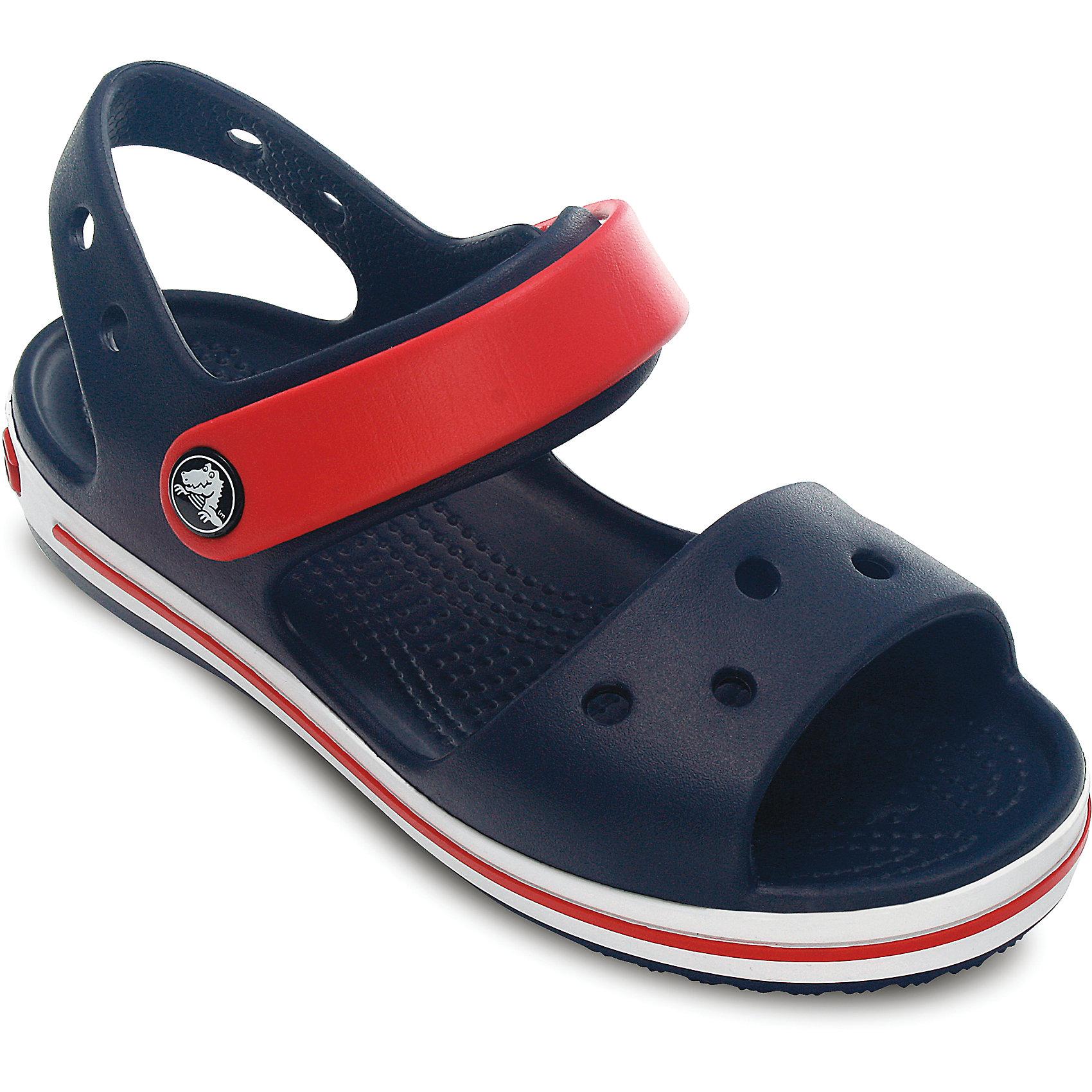 Сандалии Crocband™ Sandal Kids Crocs, синийСандалии<br>Характеристики товара:<br><br>• цвет: синий<br>• материал: 100% полимер Croslite™<br>• бактериостатичный материал<br>• ремешок фиксирует стопу<br>• антискользящая устойчивая подошва<br>• липучка<br>• анатомическая стелька с массажными точками стимулирует кровообращение<br>• страна бренда: США<br>• страна изготовитель: Китай<br><br>Для правильного развития ребенка крайне важно, чтобы обувь была удобной. <br><br>Такие сандалии обеспечивают детям необходимый комфорт, а анатомическая стелька с массажными линиями для стимуляции кровообращения позволяет ножкам дольше не уставать. <br><br>Сандалии легко надеваются и снимаются, отлично сидят на ноге. <br><br>Материал препятствует образованию неприятного запаха и появлению болезней стоп. <br><br>Продукция Crocs - это качественные товары, созданные с применением новейших технологий. <br><br>Изделие производится из качественных и проверенных материалов, которые безопасны для детей.<br><br>Сандалии от торговой марки Crocs можно купить в нашем интернет-магазине.<br><br>Ширина мм: 219<br>Глубина мм: 154<br>Высота мм: 121<br>Вес г: 343<br>Цвет: синий<br>Возраст от месяцев: 18<br>Возраст до месяцев: 21<br>Пол: Унисекс<br>Возраст: Детский<br>Размер: 23,34/35,31,30,21,26,34,33,29,28,27,25,24,22,31/32,33/34<br>SKU: 4033682
