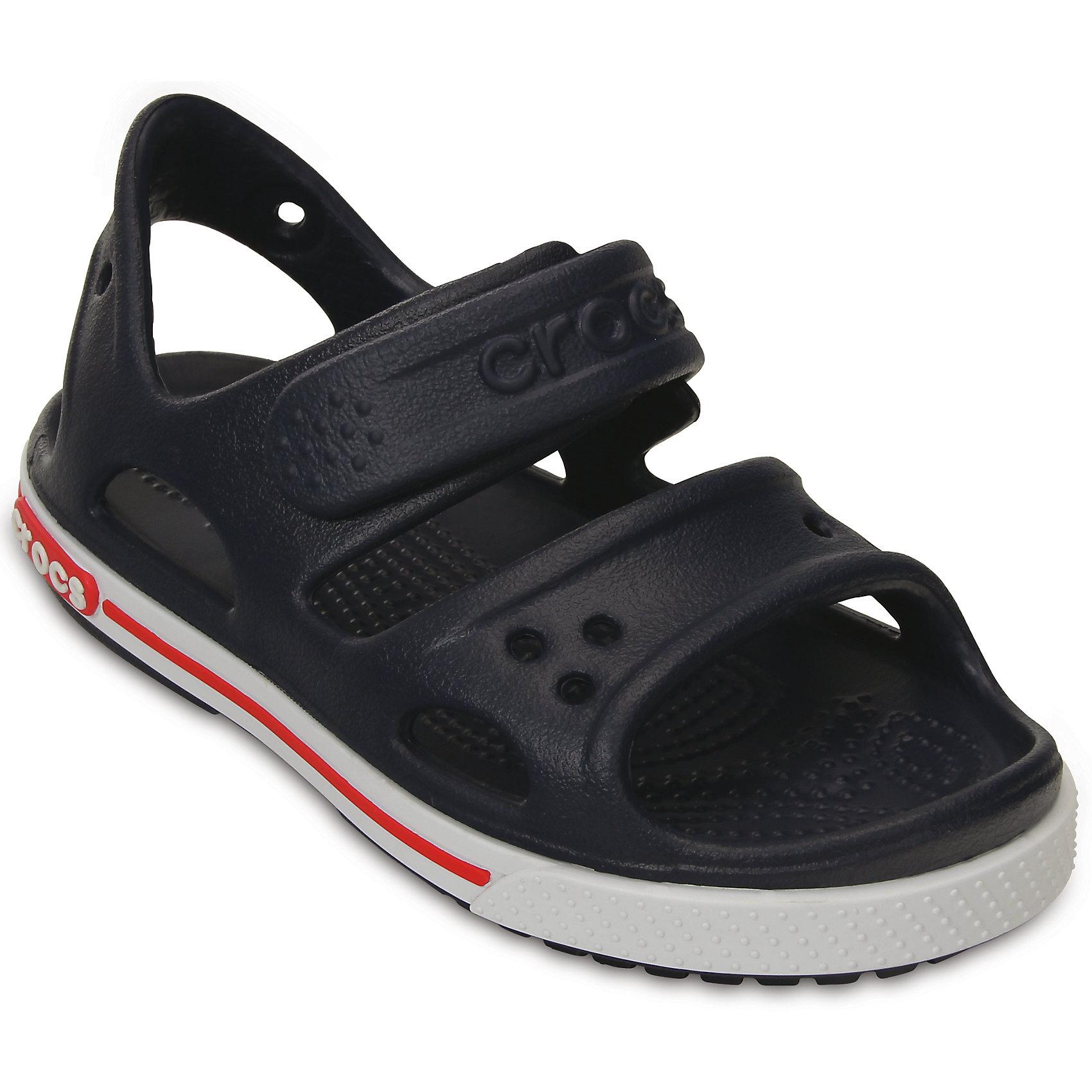 Сандалии Crocband II Sandal PS для мальчика CrocsПляжная обувь<br>Характеристики товара:<br><br>• цвет: черный<br>• материал: 100% полимер Croslite™<br>• бактериостатичный материал<br>• ремешок фиксирует стопу<br>• антискользящая устойчивая подошва<br>• липучка<br>• анатомическая стелька с массажными точками стимулирует кровообращение<br>• страна бренда: США<br>• страна изготовитель: Китай<br><br>Для правильного развития ребенка крайне важно, чтобы обувь была удобной. Такие сандалии обеспечивают детям необходимый комфорт, а анатомическая стелька с массажными линиями для стимуляции кровообращения позволяет ножкам дольше не уставать. Сандалии легко надеваются и снимаются, отлично сидят на ноге. Материал, из которого они сделаны, не дает размножаться бактериям, поэтому такая обувь препятствует образованию неприятного запаха и появлению болезней стоп. <br>Обувь от американского бренда Crocs в данный момент завоевала широкую популярность во всем мире, и это не удивительно - ведь она невероятно удобна. Её носят врачи, спортсмены, звёзды шоу-бизнеса, люди, которым много времени приходится бывать на ногах - они понимают, как важна комфортная обувь. Продукция Crocs - это качественные товары, созданные с применением новейших технологий. Обувь отличается стильным дизайном и продуманной конструкцией. Изделие производится из качественных и проверенных материалов, которые безопасны для детей.<br><br>Сандалии для мальчика от торговой марки Crocs можно купить в нашем интернет-магазине.<br><br>Ширина мм: 219<br>Глубина мм: 154<br>Высота мм: 121<br>Вес г: 343<br>Цвет: синий<br>Возраст от месяцев: 24<br>Возраст до месяцев: 24<br>Пол: Мужской<br>Возраст: Детский<br>Размер: 25,23,21,26,22,31/32,33/34,34/35,28,24,30,29,27<br>SKU: 4033717
