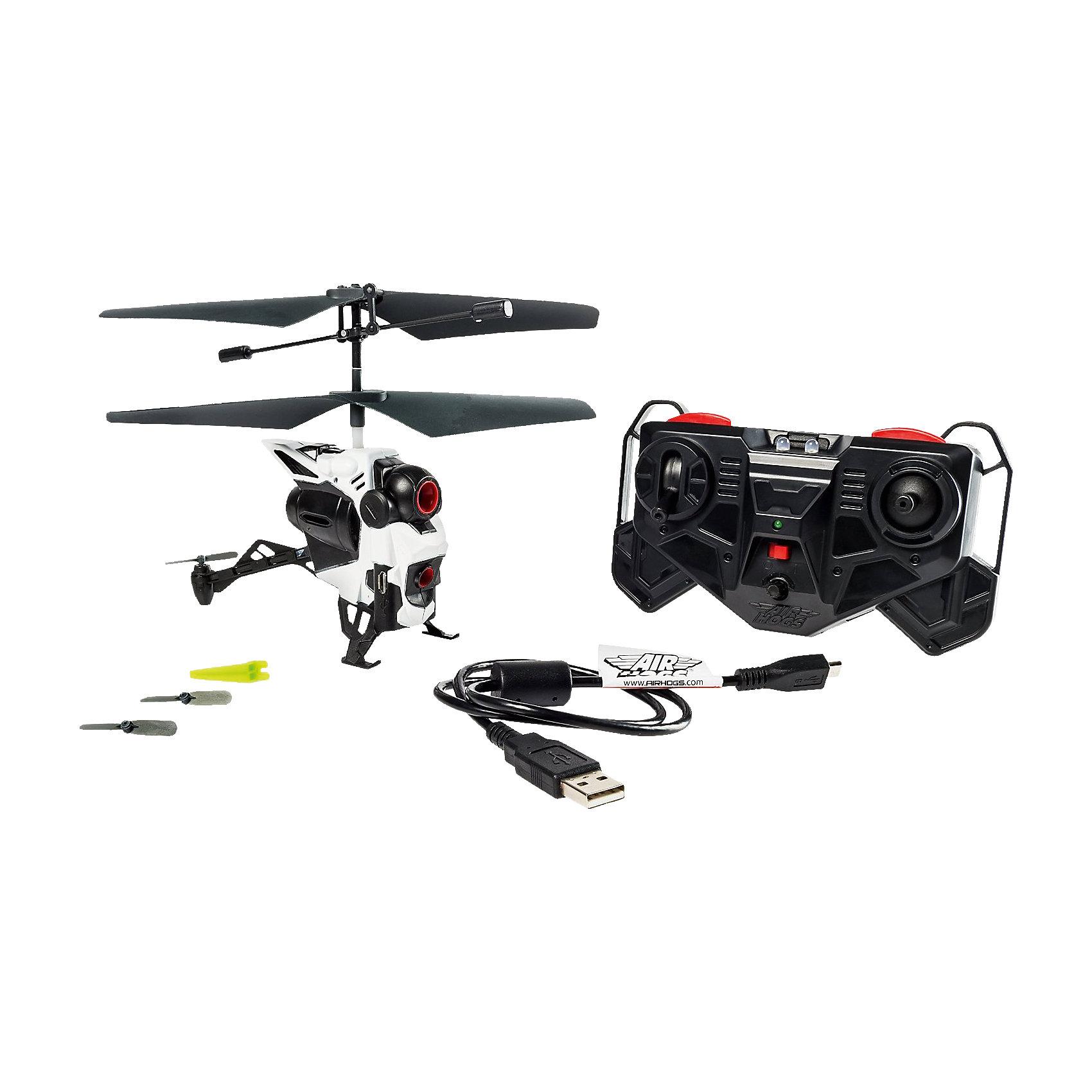 Вертолёт с камерой, AIR HOGSР/У Самолёты и вертолёты<br>Вертолёт с камерой, AIR HOGS (Эйр Хогс) может снимать видео и делать фотографии во время полета! Управление вертолетом и камерой осуществляется с помощью 3-канального инфракрасного пульта управления. Камера записывает видео и фото на встроенную память, откуда отснятый материал можно скопировать на компьютер через USB и сделать потрясающую нарезку с кадрами головокружительного полета!<br><br>Характеристики:<br>-Полная зарядка аккумулятора: 40 минут<br>-5 минут непрерывного полета<br>-Питание: встроенный аккумулятор 3.7V LiPo<br>-Управление: пульт д/у<br>-Возможности: фото-видеосъемка с разрешением 0,3 мегапикселя<br>-Зарядка: от ПК или других устройств при помощи USB-кабеля <br>-Объем встроенной памяти: 128 мегабайт<br>-Предназначен для полетов в помещении или на улице в сухую безветренную погоду<br>-Изготовлен из ударопрочного материала <br>-Встроенный гироскоп и система стабилизации обеспечивает плавность полета и видеоматериала<br><br>Комплектация: вертолет, пульт управления, USB-кабель, устройство для снятия рулевого винта, 2 дополнительных рулевых винта, инструкция<br><br>Дополнительная информация:<br>-Материалы: пластик, металл<br>-Размеры в упаковке: 30,5х7х28 см<br>-Вес в упаковке: 550 г<br>-Требуются 3 батарейки типа ААА (в набор НЕ входят)<br>-Размеры вертолета: 16х13х5 см<br><br>Потрясающий радиоуправляемый вертолет с камерой, подаренный ребенку, захватит дух и вызовет бурю положительных эмоций!<br><br>Вертолёт с камерой, AIR HOGS (Эйр Хогс) можно купить в нашем магазине.<br><br>Ширина мм: 279<br>Глубина мм: 95<br>Высота мм: 305<br>Вес г: 520<br>Возраст от месяцев: 120<br>Возраст до месяцев: 180<br>Пол: Мужской<br>Возраст: Детский<br>SKU: 4038004