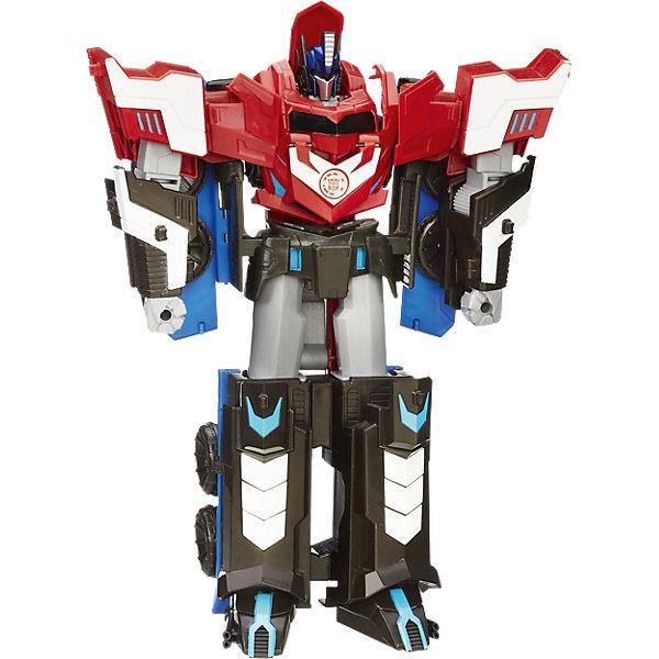 МЕГА Оптимус Прайм, Роботс-ин-Дисгайз, ТрансформерыИгрушки<br>МЕГА Оптимус Прайм, Роботс-ин-Дисгайз, Трансформеры, не оставит равнодушными всех поклонников фантастических роботов-трансформеров (Transformers). Серия Robots In Disguise создана по мотивам популярных фильмов и комиксов о роботах-трансформерах и включает в себя фигуры роботов, которые Вы легко сможете преобразовать в транспортное средство, фантастического динозавра или мощный спортивный автомобиль. Оптимус Прайм (Optimus Prime) - самый известный персонаж вселенной Трансформеры, он лидер автоботов, сильный воин, пользующийся заслуженным уважением среди всех автоботов. Фигура робота высотой целых 30 см. отличается высокой степенью детализации и реалистичностью, с помощью всего трех движений Вы легко трансформируете его в гигантский яркий грузовик и обратно в робота. Собрав вместе всех роботов серии Ваш ребенок сможет устаивать настоящие сражения.<br><br>Дополнительная информация:<br><br>- Материал: пластик.<br>- Высота фигурки: 30 см.<br>- Размер упаковки: 30 x 23 x 8,2 см.<br>- Вес: 0,249 кг.<br>Внимание! Фигурки мини-конов не входят в комплект и помещены на изображение в качестве примера.<br><br>Игрушку МЕГА Оптимус Прайм, Роботс-ин-Дисгайз, Трансформеры можно купить в нашем интернет-магазине.<br><br>Ширина мм: 307<br>Глубина мм: 230<br>Высота мм: 82<br>Вес г: 588<br>Возраст от месяцев: 72<br>Возраст до месяцев: 120<br>Пол: Мужской<br>Возраст: Детский<br>SKU: 4156400