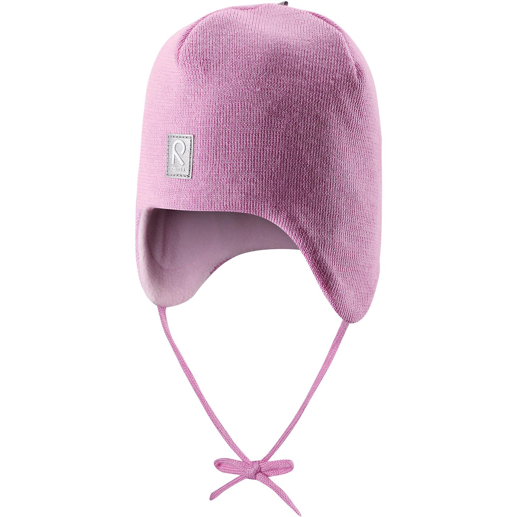Шапка для девочки ReimaШапки и шарфы<br>Любимая шапка малышей в модных цветах сезона надёжно согреет в холодные зимние дни! Шерстяная шапка для малышей согреет в морозную погоду: мягкая подкладка из флиса для тепла и комфорта. Шерстяная шапка с подкладкой из флиса особенно подходит для маленьких приключений на свежем воздухе, потому что флис быстро высыхает и хорошо выводит влагу. Благодаря эластичной вязке шапка плотно прилегает, а ветронепроницаемые вставки в области ушей защищают маленькие ушки от холодного ветра. Завязки надёжно фиксируют шапку на голове и не натирают. Для завершения стильного образа носите с тёплой горловиной Star!<br><br>Шерстяная шапка для малышей <br>Полностью на подкладке: Мягкий тёплый флис<br>Ветронепроницаемые вставки в области ушей <br>Доступна в однотонном и полосатом вариантах<br>Состав:<br>100% Шерсть<br><br><br>Шапку Reima (Рейма) можно купить в нашем магазине.<br><br>Ширина мм: 89<br>Глубина мм: 117<br>Высота мм: 44<br>Вес г: 155<br>Цвет: розовый<br>Возраст от месяцев: 6<br>Возраст до месяцев: 9<br>Пол: Женский<br>Возраст: Детский<br>Размер: 46,50,52,48<br>SKU: 4208660