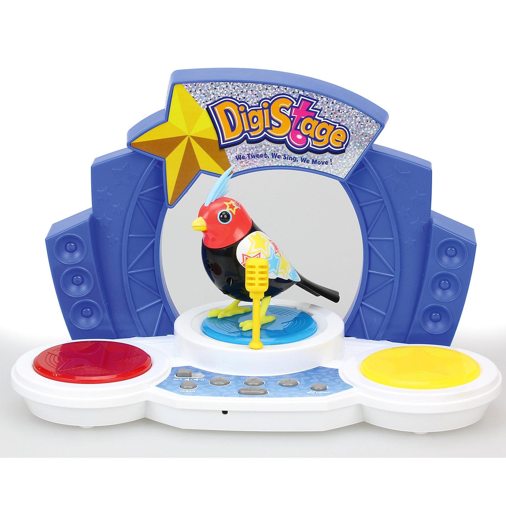 Поющая птичка со сценой, DigiBirdsИнтерактивные животные<br>Поющая птичка со сценой, DigiBirds, - оригинальная игрушка, которая вызовет интерес у детей любого возраста. Очаровательная птичка споет Вам со сцены более 58 мелодий и песен. У птички яркое красочное оперение, красная головка с голубым хохолком и нарядные крылышки, украшенные разноцветными звездочками. Чтобы птичка защебетала, нужно посвистеть в кольцо-свисток (входит в комплект). Ребенок может использовать свисток и как кольцо, надев его на палец и закрепив на нем птичку, и как насест для своего питомца. <br><br>На игрушечной сцене расположены кнопки проигрывания мелодий. Птичка может петь соло или в такт играющей мелодии в режиме хор. Вы можете слушать мелодии в произвольном порядке (кнопка SHUFFLE) или составить собственный плейлисте (к игрушке прилагается карточка с 4-х значными кодами популярных песен). Игрушка совместима с другими птичками из серии Digibirds. На игрушечной сцене помещается до трех птичек Digibirds, вы можете устроить настоящее представление, синхронизировав сразу несколько птичек. Главным в хоре становится персонаж, которого включили первым.<br><br>Дополнительная информация:<br><br>- В комплекте: птичка, сцена с кнопками управления игрушкой, микрофон, свисток для активизации птички, наклейки.<br>- Материал: пластмасса.<br>- Требуются батарейки: 3 х LR44 (не входят в комплект).<br>- Размер птички: 7 см.<br>- Размер упаковки: 25,5 x 21,5 x 13,5 см.<br>- Вес: 0,573 кг.<br><br>Поющую птичку со сценой, DigiBirds, можно купить в нашем интернет-магазине.<br><br>Ширина мм: 133<br>Глубина мм: 216<br>Высота мм: 254<br>Вес г: 573<br>Возраст от месяцев: 36<br>Возраст до месяцев: 84<br>Пол: Унисекс<br>Возраст: Детский<br>SKU: 4310793