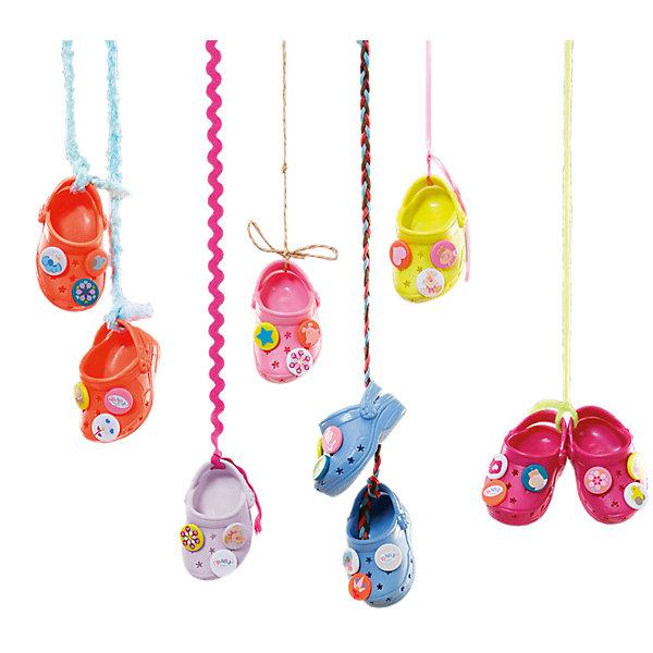 Сандали фантазийные, BABY born, в ассортиментеБренды кукол<br>Сандали фантазийные, BABY born, в ассортименте – помогут разнообразить гардероб вашей куколки.<br>Необычные и яркие сандалики сделаны специально для куклы Бэби Борн. Дизайнерские ботиночки имеют крепление с застежкой, которая не дает обуви слететь с ножки куклы. Сделаны сандалики из качественного материала, который абсолютно безопасен для детей и не вызывает аллергии. <br><br>Дополнительная информация:<br><br>- в упаковке одна пара<br>- ВНИМАНИЕ! Данный артикул имеется в наличии в разных цветовых исполнениях. К сожалению, заранее выбрать определенный цвет не возможно. <br>- ширина: 178 мм<br>- глубина:  129 мм<br>- высота: 40 мм<br>- вес: 84 г<br>- возраст: 36 месяцев<br><br>Сандали фантазийные, BABY born, в ассортименте можно купить в нашем интернет магазине.<br>Ширина мм: 178; Глубина мм: 129; Высота мм: 40; Вес г: 84; Возраст от месяцев: 36; Возраст до месяцев: 60; Пол: Женский; Возраст: Детский; SKU: 4319372;