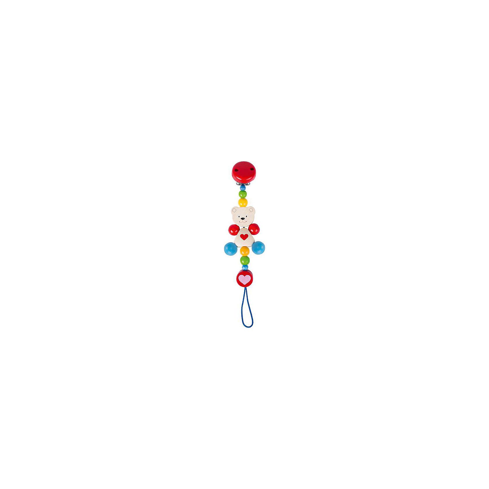 Держательс клипсойМедвежонок с сердцем, HEIMESSДержатель с клипсой Медвежонок с сердцем, HEIMESS (ХАЙМЕСС) – держатель для соски, который можно использовать как развивающую игрушку.<br>Деревянный держатель с клипсой Медвежонок с сердцем от немецкого бренда Heimess (Хаймесс) не позволит пустышке случайно упасть. Его можно использовать с рождения. Яркий красивый держатель для соски состоит из разноцветных деревянных элементов в виде шариков, и фигурки медвежонка. Держатель сделан из легкого дерева, прищепка - из металла. Металлическая прищепка закрыта деревянным кружочком, поэтому малыш не сможет пораниться об нее. Длина держателя рассчитана таким образом, чтобы он не стеснял движений малыша и не смог обвить шею ребенка. Пустышка крепится с помощью петельки. Можно использовать два вида сосок: имеющие колечки крепятся стандартно «петля в петлю», а соска без кольца затягивается в петлю с помощью деревянного язычка с надписью Heimess. Подросшему малышу держатель будет интересен как развивающая игрушка. Он с интересом будет перебирать элементы держателя, рассматривать их форму и цвет. Все детали очень гладкие и абсолютно безопасны для малыша. Держатель изготовлен из качественной древесины и покрыт стойкими безопасными красками на водной основе. Важной особенностью является поверхностная пропитка элементов держателя, что исключает возможность сколов и отслоений краски. HEIMESS (ХАЙМЕСС) - крупный немецкий производитель детских игрушек из дерева. Это игрушки с историей и традициями настоящего немецкого производства. Качество и безопасность этих игрушек доказаны, более чем 50 летним опытом. Вся продукция под брендом HEIMESS (ХАЙМЕСС) производится непосредственно в Германии.<br><br>Дополнительная информация:<br><br>- Материал: древесина, стойкие краски на водной основе<br>- Длина: 21 см.<br>- Вес: 23 гр.<br><br>Держатель с клипсой Медвежонок с сердцем, HEIMESS (ХАЙМЕСС) можно купить в нашем интернет-магазине.<br><br>Ширина мм: 210<br>Глубина мм: 50<br>Высота мм: 210<br>Вес г: