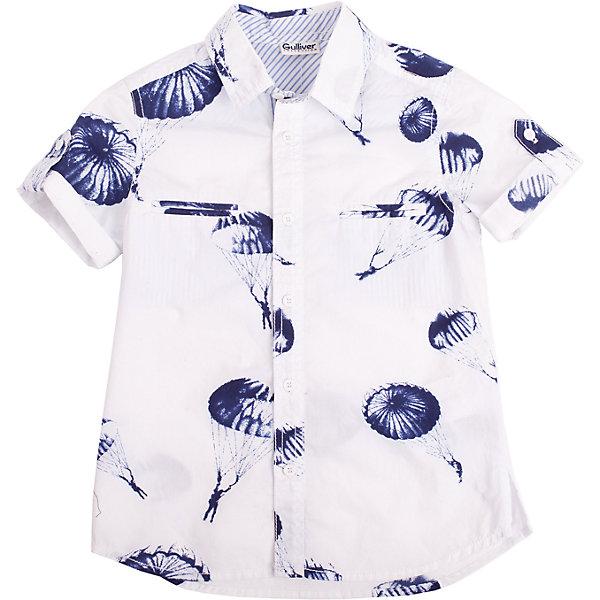 Рубашка для мальчика GulliverБлузки и рубашки<br>Рубашка с коротким рукавом и выразительным принтом для мальчика - хит сезона Весна/Лето 2016! И это не случайно. Она делает образ ребенка свежим, интересным, оригинальным! Рубашка с классным графическим рисунком в стиле коллекции Воздухоплаватели выполнена из 100% хлопка. Она имеет модный силуэт и, естественно, носится только навыпуск! Если вы решили купить стильную рубашку для мальчика, присмотритесь к этой модели! Великолепный принт, удобная форма, эффектная отделка, отличное качество, бесспорно, придутся по вкусу ее обладателю!<br>Состав:<br>100% хлопок<br><br>Ширина мм: 174<br>Глубина мм: 10<br>Высота мм: 169<br>Вес г: 157<br>Цвет: белый<br>Возраст от месяцев: 48<br>Возраст до месяцев: 60<br>Пол: Мужской<br>Возраст: Детский<br>Размер: 110,98,122,104,116<br>SKU: 4534776