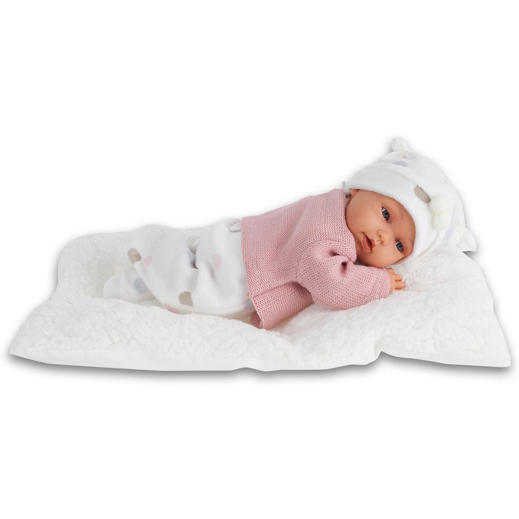 Кукла Ману в розовом, 29 см, Munecas Antonio JuanИнтерактивные куклы<br>Кукла Ману в розовом, 29 см, Munecas Antonio Juan (Мунекас Антонио Хуан) - милая малышка подарит вашей девочке много положительных эмоций.<br>Кукла Ману выглядит как настоящий младенец, а ее трогательный внешний вид вызывает только самые положительные и добрые эмоции. Эта чудесная милая малышка станет любимицей Вашей девочки и будет воспитывать в ней доброту, внимание и заботу. Личико куклы сделано с детальными прорисовками. Пухлые щечки, приоткрытые губки, выразительные глаза с пушистыми ресницами придают кукле реалистичный вид. Ману одета в розовую утепленную кофточку, мягкие ползунки в горошек и белую шапочку с помпончиками. Кукла лежит на одеяле. При нажатии на животик куклы, она весело смеется, а так же может позвать маму и папу. Тельце у нее мягко-набивное, голова, ручки и ножки сделаны из высококачественного винила. Голова, ручки и ножки подвижны. Кукла изготовлена из высококачественных и экологически чистых материалов, поэтому безопасна для детей любого возраста, соответствует всем нормам и требованиям к качеству детских товаров. Образы малышей Мунекас разработаны известными европейскими дизайнерами. Они натуралистичны, анатомически точны. Кукла упакована в красивую подарочную коробку.<br><br>Дополнительная информация:<br><br>- В комплекте: кукла, одеяло<br>- Интерактивные функции куклы: нажмите на животик 1 раз кукла засмеется, 2ой раз - кукла скажет мама, 3ий раз - скажет папа<br>- Глаза куклы не закрываются<br>- Высоты куклы: 29 см.<br>- Материал: высококачественный винил, текстиль<br>- Батарейки: 3 типа АА (входят в комплект)<br>- Упаковка: подарочная коробка<br>- Размер упаковки: 35х20х12,5 см.<br>- Вес: 800 гр.<br><br>Куклу Ману в розовом, 29 см, Munecas Antonio Juan (Мунекас Антонио Хуан) можно купить в нашем интернет-магазине.<br><br>Ширина мм: 350<br>Глубина мм: 200<br>Высота мм: 125<br>Вес г: 800<br>Возраст от месяцев: 36<br>Возраст до месяцев: 84<br>Пол: Женский<br>Возраст: Де