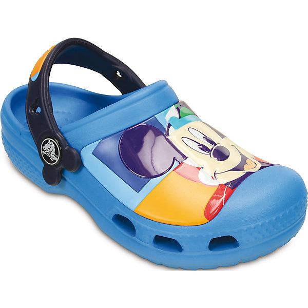 Сабо CC Mickey Colorblock Clog K CrocsПляжная обувь<br>Характеристики товара:<br><br>• цвет: голубой<br>• принт: Микки Маус<br>• сезон: лето<br>• тип: пляжная обувь<br>• материал: 100% полимер Croslite™<br>• под воздействием температуры тела принимают форму стопы<br>• полностью литая модель<br>• вентиляционные отверстия<br>• бактериостатичный материал<br>• пяточный ремешок фиксирует стопу<br>• отверстия для использования украшений<br>• анатомическая стелька с массажными точками<br>• страна бренда: США<br>• страна изготовитель: Китай<br><br>Для правильного развития ребенка крайне важно, чтобы обувь была удобной.<br><br>Такие сабо обеспечивают детям необходимый комфорт, а анатомическая стелька с массажными линиями для стимуляции кровообращения позволяет ножкам дольше не уставать. <br><br>Сабо легко надеваются и снимаются, отлично сидят на ноге. <br><br>Материал, из которого они сделаны, не дает размножаться бактериям, поэтому такая обувь препятствует образованию неприятного запаха и появлению болезней стоп.<br><br>Обувь от американского бренда Crocs в данный момент завоевала широкую популярность во всем мире, и это не удивительно - ведь она невероятно удобна. <br><br>Её носят врачи, спортсмены, звёзды шоу-бизнеса, люди, которым много времени приходится бывать на ногах - они понимают, как важна комфортная обувь. <br><br>Продукция Crocs - это качественные товары, созданные с применением новейших технологий. <br><br>Обувь отличается стильным дизайном и продуманной конструкцией. Изделие производится из качественных и проверенных материалов, которые безопасны для детей.<br><br>Сабо Kids Classic от торговой марки Crocs можно купить в нашем интернет-магазине.<br><br>Ширина мм: 225<br>Глубина мм: 139<br>Высота мм: 112<br>Вес г: 290<br>Цвет: синий<br>Возраст от месяцев: 132<br>Возраст до месяцев: 144<br>Пол: Унисекс<br>Возраст: Детский<br>Размер: 34/35,31/32,29/30,33/34,27/28,23/24,21/22,25/26,34/35<br>SKU: 4639461