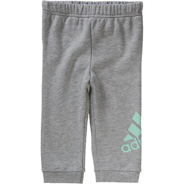 Трикотажные брюки adidasПолзунки и штанишки<br>Трикотажные брюки Аdidas (Адидас).<br><br>Характеристики:<br><br>• цвет: серый;<br>• состав: 70 % хлопок, 30 % полиэстер<br>• эластичная резинка на талии<br>• графическая печать adidas на левой ноге<br>• эластичные манжеты на лодыжках<br>• машинная стирка при 30 °<br><br>Трикотажные брюки от известного бренда Аdidas (Адидас)-эти удобные спортивные брюки отлично впишутся в гардероб  вашего ребенка. Удобный рифленый пояс плотно прилегает к телу. Дополнительно  брюки фиксируются на  поясе шнурком. Брючины собраны на тянущиеся манжеты снизу Большой логотип Adidas на левой ноге снизу. Хлопок в составе ткани обеспечивает комфорт и обладает гипоаллергенными свойствами. Данная модель хорошо сидит на ребенке и отлично сочетается с другой спортивной одеждой. <br><br>Трикотажные брюки Аdidas (Адидас), можно купить в нашем интернет-магазине.<br>Ширина мм: 336; Глубина мм: 215; Высота мм: 53; Вес г: 102; Цвет: серый; Возраст от месяцев: 9; Возраст до месяцев: 12; Пол: Унисекс; Возраст: Детский; Размер: 80,104,86,92,98; SKU: 4753682;