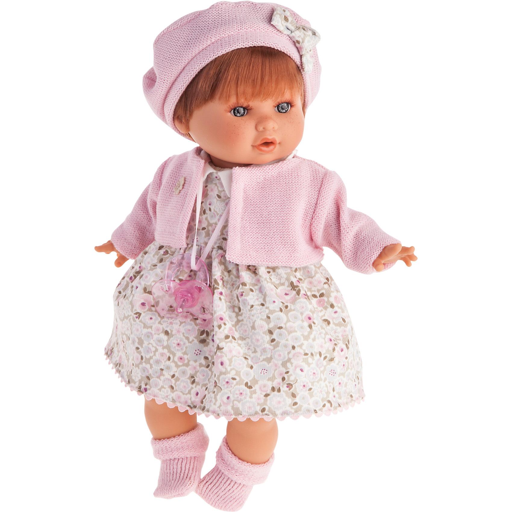Кукла Кристиана в розовом, 30 см, Munecas Antonio JuanКлассические куклы<br>Кукла Кристиана в розовом, 30 см, JUAN ANTONIO munecas (Мунекас от Антонио Хуан) ? это очаровательная малышка от всемирно известного испанского бренда Мунекас от Антонио Хуан, который знаменит своими реалистичными куклами. Кукла изготовлена из винила высшего качества, ее тело ? мягконабивное, густые короткие волосы можно расчесывать. Ручки и ножки подвижны, глазки не закрываются. <br>Малышка Кристиана настолько очаровательна, что перед ней просто невозможно устоять! Настоящая блондинка с голубыми глазами, нежными чертами лица, розовыми щечками и пухленькими губками.  <br>Кукла Кристиана в розовом, 30 см, JUAN ANTONIO munecas (Мунекас от Антонио Хуан) разработана с учетом анатомических особенностей и мимики младенцев. Играя с Кристианой, ваш ребенок реалистично проживает роль «мамы», учится ухаживать за малышом, заботиться о нем.<br>В комплекте с куклой идет соска, если ее достать из ротика, то Кристиана начинает плакать. <br>Одежда куклы разработана современными европейскими дизайнерами: платье Кристианы в нежный цветочек с белым воротничком и розовой каймой по низу. Сверху на ней одет трикотажный жакет розового цвета, носочки и берет в тон к нему. Весь комплект одежды и его продуманные детали направлены на то, чтобы способствовать формированию чувства стиля и вкуса в одежде у вашей девочки.<br>Куклы JUAN ANTONIO munecas (Мунекас от Антонио Хуан) ? мечта девочки любого возраста!<br><br>Дополнительная информация:<br><br>- Вид игр: сюжетно-ролевые игры <br>- Дополнительные функции: плачет<br>- Материал: пластик, винил, текстиль<br>- Высота куклы: 30 см<br>- Вес: 7 кг 870 г<br>- Батарейки: 3 шт. АА<br>- Особенности ухода: одежда ? ручная стирка, саму куклу мыть не рекомендуется <br><br>Подробнее:<br><br>• Для детей в возрасте: от 3 лет и до 6 лет<br>• Страна производитель: Испания<br>• Торговый бренд: JUAN ANTONIO munecas <br><br>Куклу Кристиану в розовом, 30 см, JUAN ANTONIO munecas (Мунекас о