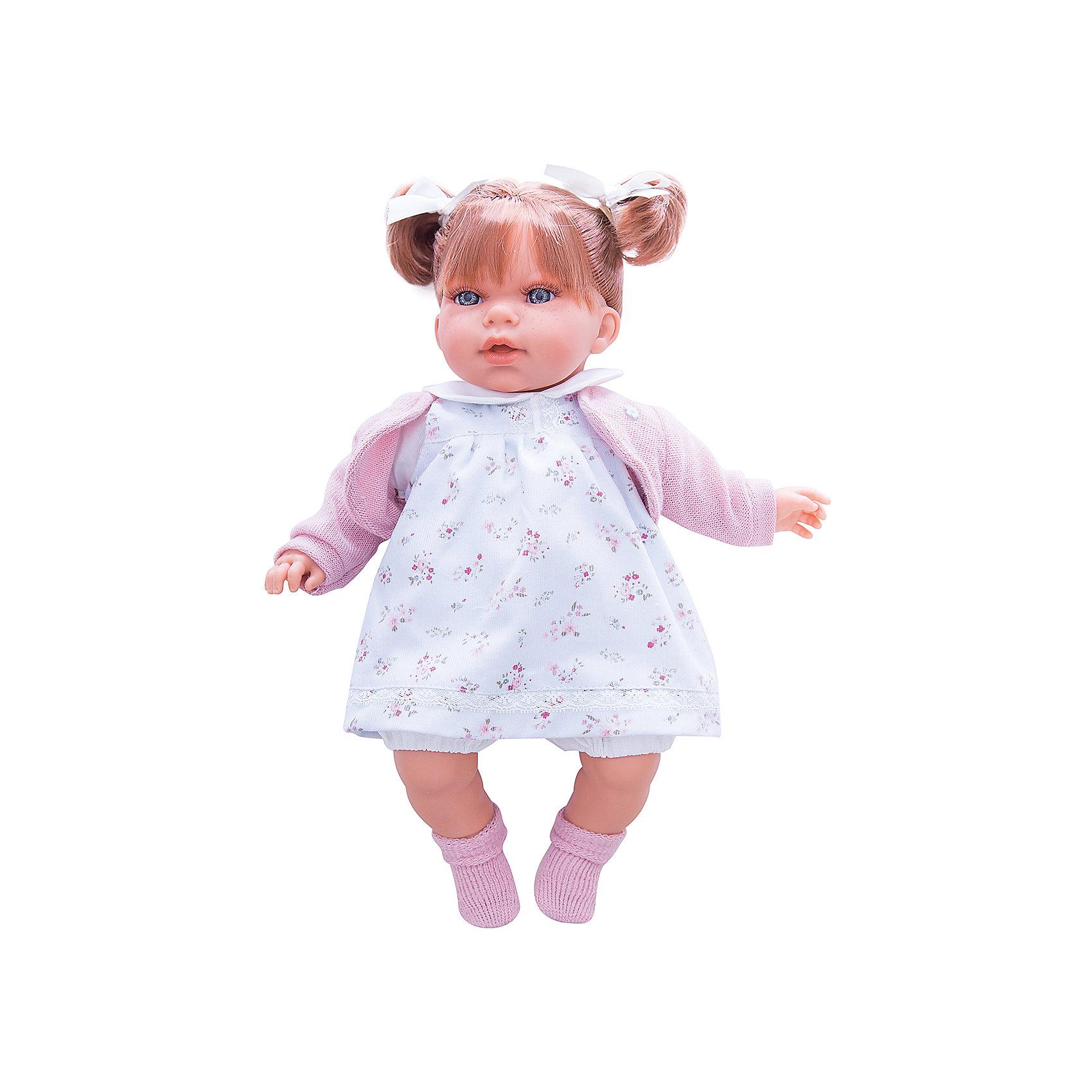 Кукла Лорена в белом, 37 см, Munecas Antonio JuanКлассические куклы<br>Кукла Лорена в белом, 37 см, Munecas Antonio Juan (Мунекас от Антонио Хуан) ? это очаровательная маленькая девочка от всемирно известного испанского бренда Мунекас от Антонио Хуан, который знаменит своими реалистичными куклами. Кукла изготовлена из винила высшего качества, ее тело ? мягконабивное, ручки и ножки подвижны, голова поворачивается в стороны, глазки не закрываются. <br>Нежные черты лица, розовые щечки, пухленькие губки, курносый носик и рыжие волосы, собранные в два очаровательных хвостика.  Лорена умеет смеяться и говорить «мама» и «папа», если ей нажать на животик. <br>Кукла Лорена в белом, 37 см, Munecas Antonio Juan (Мунекас от Антонио Хуан) разработана с учетом анатомических особенностей и мимики младенцев. Играя с пупсом, ваш ребенок реалистично проживает роль «мамы», учится ухаживать за малышом, заботиться о нем.<br>У малышки Лорены красивый наряд: нежное платьице с цветочным принтом, теплая розовая кофточка, на ножках розовые носочки.<br>Куклы JUAN ANTONIO munecas (Мунекас от Антонио Хуан) ? мечта девочки любого возраста!<br><br>Дополнительная информация:<br><br>- Вид игр: сюжетно-ролевые игры <br>- Дополнительные функции: смеется, говорит «мама» и «папа»<br>- Материал: пластик, винил, текстиль<br>- Высота куклы: 37 см<br>- Вес: 6 кг <br>- Батарейки: 3 шт. 3 LR44 (в комплекте)<br>- Особенности ухода: одежда ? ручная стирка, саму куклу мыть не рекомендуется <br><br>Подробнее:<br><br>• Для детей в возрасте: от 3 лет и до 6 лет<br>• Страна производитель: Испания<br>• Торговый бренд: JUAN ANTONIO munecas <br><br>Куклу Лорену в белом, 37 см, Munecas Antonio Juan (Мунекас от Антонио Хуан) (Мунекас от Антонио Хуан) можно купить в нашем интернет-магазине.<br><br>Ширина мм: 440<br>Глубина мм: 245<br>Высота мм: 120<br>Вес г: 6000<br>Возраст от месяцев: 36<br>Возраст до месяцев: 72<br>Пол: Женский<br>Возраст: Детский<br>SKU: 4792903