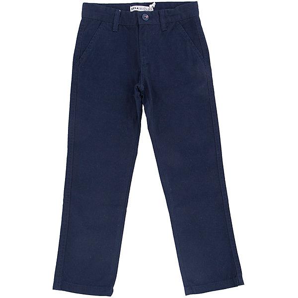 Брюки для мальчика SELAБрюки<br>Классические брюки - незаменимая вещь в детском гардеробе. Эта модель отлично сидит на ребенке, она сшита из плотного материала, натуральный хлопок не вызывает аллергии и обеспечивает ребенку комфорт. Модель станет отличной базовой вещью, которая будет уместна в различных сочетаниях.<br>Одежда от бренда Sela (Села) - это качество по приемлемым ценам. Многие российские родители уже оценили преимущества продукции этой компании и всё чаще приобретают одежду и аксессуары Sela.<br><br>Дополнительная информация:<br><br>прямой силуэт;<br>материал: 100% хлопок;<br>плотный материал.<br><br>Брюки для мальчика от бренда Sela можно купить в нашем интернет-магазине.<br>Ширина мм: 215; Глубина мм: 88; Высота мм: 191; Вес г: 336; Цвет: синий; Возраст от месяцев: 132; Возраст до месяцев: 144; Пол: Мужской; Возраст: Детский; Размер: 140,134,128,122,152,116,146; SKU: 4883584;