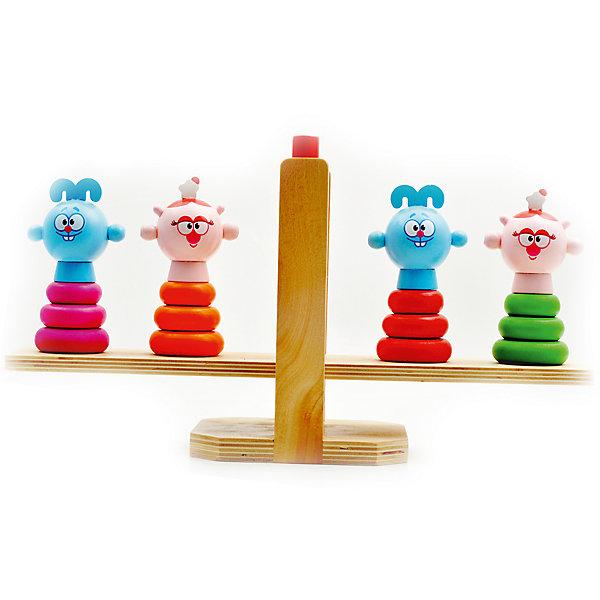 Весы Крош и Нюша, Мир деревянных игрушекСмешарики<br>Весы Крош и Нюша – обучение с любимыми героями!<br>Весы обучают ребенка уравновешивать стороны и понимать цвета, развивают логическое мышление и мелкую моторику рук. В комплекте идут 16 фигурок зеленого, красного, розового и оранжевого цвета. А вершинки пирамидок – любимые детьми герои Крош и Нюша. Игрушка изготовлена из натурального дерева, с закругленными концами, что делает ее безопасной для малыша. <br><br>Дополнительная информация:<br>- размер: 300х100х170<br>- вес: 645 г<br>- материал: дерево<br>- возраст: от 2 лет<br><br>Весы Крош и Нюша можно купить в нашем интернет-магазине.<br>Ширина мм: 300; Глубина мм: 100; Высота мм: 170; Вес г: 645; Возраст от месяцев: 36; Возраст до месяцев: 2147483647; Пол: Унисекс; Возраст: Детский; SKU: 4895863;