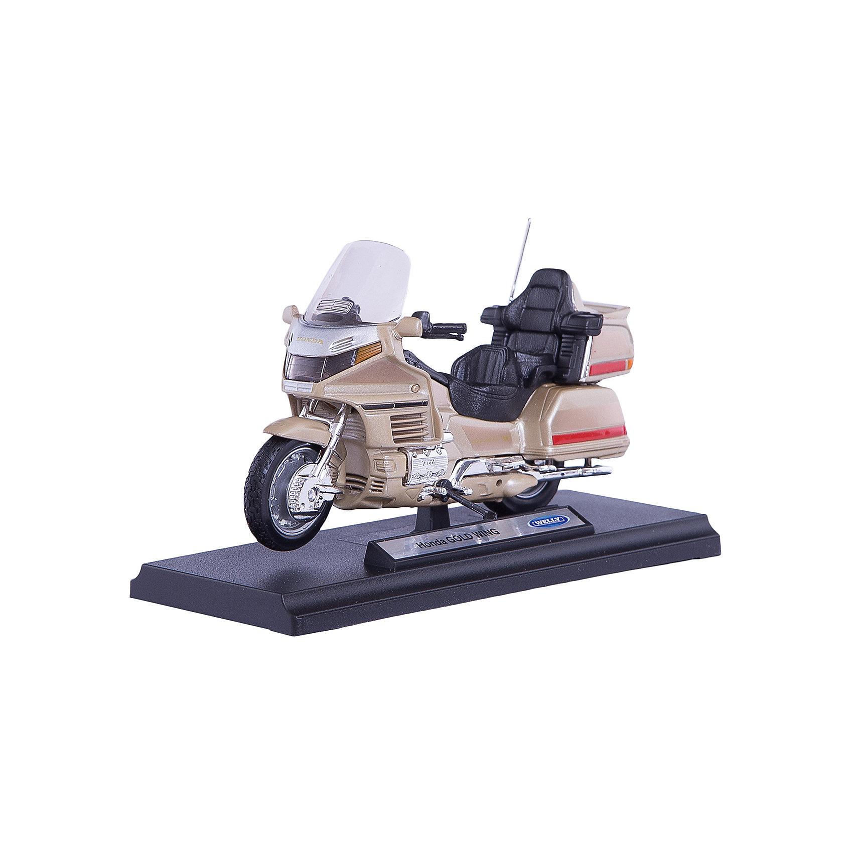 Модель мотоцикла 1:18 Honda Gold Wing, WellyКоллекционные модели<br>Модель мотоцикла Welly 1:18 HONDA Gold Wing<br><br>Ширина мм: 70<br>Глубина мм: 110<br>Высота мм: 170<br>Вес г: 205<br>Возраст от месяцев: 36<br>Возраст до месяцев: 192<br>Пол: Мужской<br>Возраст: Детский<br>SKU: 4966471