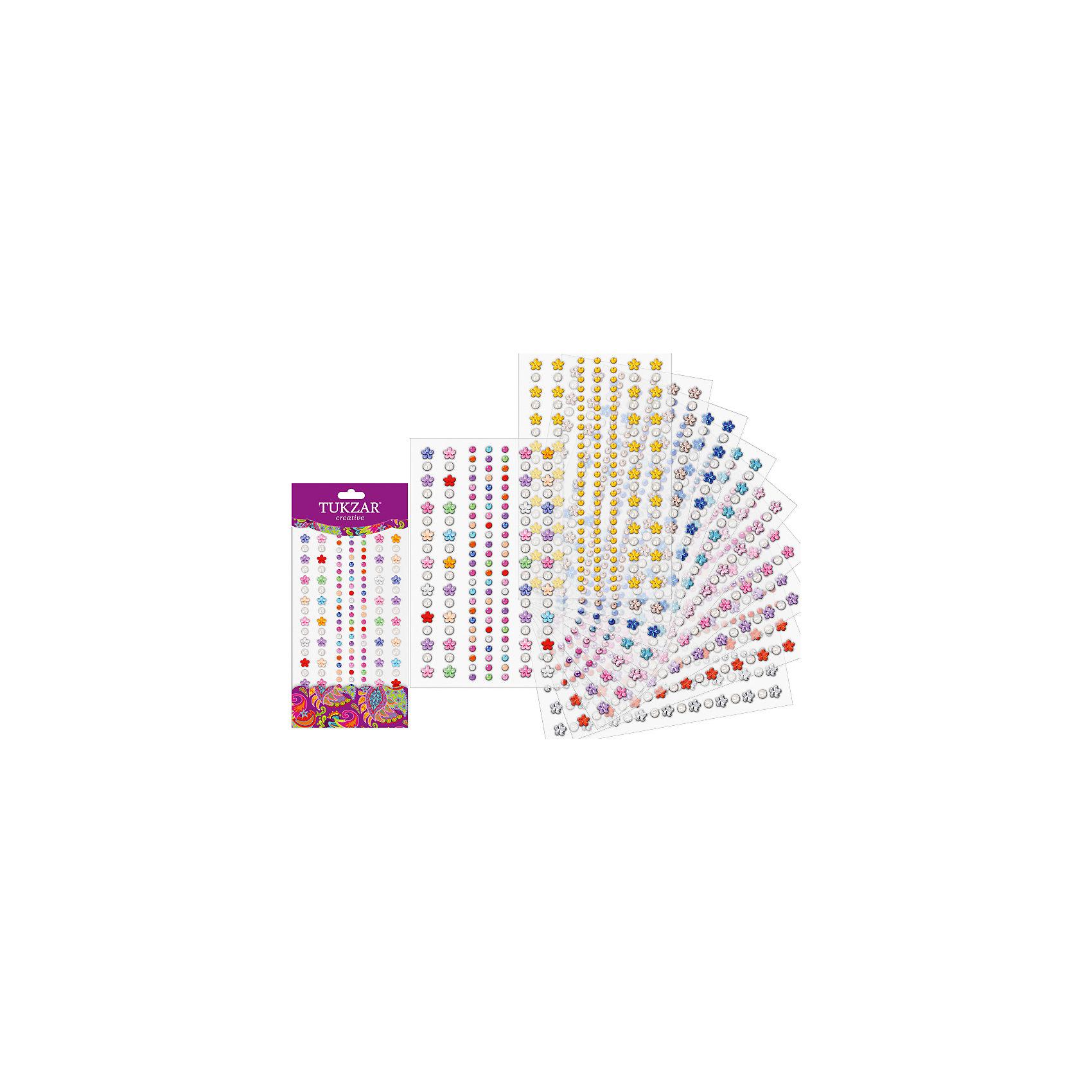 Акриловые наклейки-стразы и жемчуг Цветочки и кружочкиТворчество для малышей<br>Акриловые наклейки-стразы и жемчуг Цветочки и кружочки от известного торгового бренда канцелярских товаров и товаров для творчества TUKZAR. Наклейки-стразы можно использовать для оформления и декорирования ручных поделок, оформления подарочной упаковки или в качестве стильного аксессуара для маскарадного костюма. Набор включает в себя различные по цвету стразы в форме кружочков и цветочков разного цвета, что позволит создать любые авторские узоры.<br><br>Дополнительная информация:<br><br>- Предназначение: для творческих занятий, оформительских работ и декорирования<br>- Материал: акрил<br>- Комплектация: наклейки-стразы в форме кружлчкв и цветочков<br>- Размеры (Д*Ш): 10*23 см<br>- Упаковка: блистер<br><br>Подробнее:<br><br>• Для детей в возрасте: от 5 лет <br>• Страна производитель: Китай<br>• Торговый бренд: TUKZAR<br><br>Акриловые наклейки-стразы и жемчуг Цветочки и кружочки можно купить в нашем интернет-магазине.<br><br>Ширина мм: 100<br>Глубина мм: 230<br>Высота мм: 10<br>Вес г: 50<br>Возраст от месяцев: 36<br>Возраст до месяцев: 144<br>Пол: Женский<br>Возраст: Детский<br>SKU: 5001404