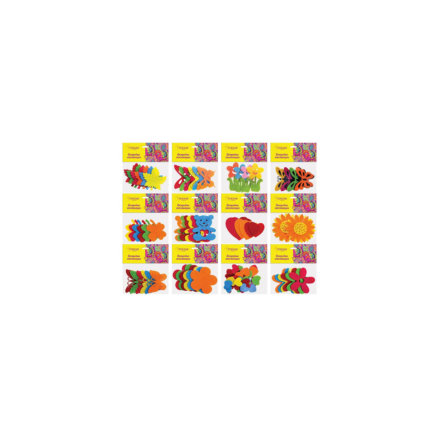 Фетровые аппликации 12*10 см, (12 дизайнов в ассортименте)Фетровые аппликации 12*10 см (12 дизайнов в ассортименте) от известного торгового бренда канцелярских товаров и товаров для творчества TUKZAR. Набор включает в себя разноцветные заготовки животных, растений и других предметов для занятий аппликацией с детьми дошкольного и младшего школьного возраста. Комплектация позволяет создавать сюжетные картинки. Кроме того, данные заготовки можно использовать в качестве меток для детской одежды.<br>Фетровые аппликации 12*10 см (12 дизайнов в ассортименте) способствуют развитию у ребенка внимания, усидчивости, воображения и фантазии.<br><br>Дополнительная информация:<br><br>- Предназначение: для аппликаций<br>- Материал: фетр<br>- Комплектация: 12 дизайнов (бабочки, цветочки, сердечки, кленовые листики, медвежата)<br>- Размеры упаковки (Д*В): 10*12 см<br>- Упаковка: полиэтилен<br><br>Подробнее:<br><br>• Для детей в возрасте: от 3 лет <br>• Страна производитель: Китай<br>• Торговый бренд: TUKZAR<br><br>Фетровые аппликации 12*10 см (12 дизайнов в ассортименте) можно купить в нашем интернет-магазине.<br><br>Ширина мм: 120<br>Глубина мм: 100<br>Высота мм: 10<br>Вес г: 50<br>Возраст от месяцев: 36<br>Возраст до месяцев: 72<br>Пол: Унисекс<br>Возраст: Детский<br>SKU: 5001417