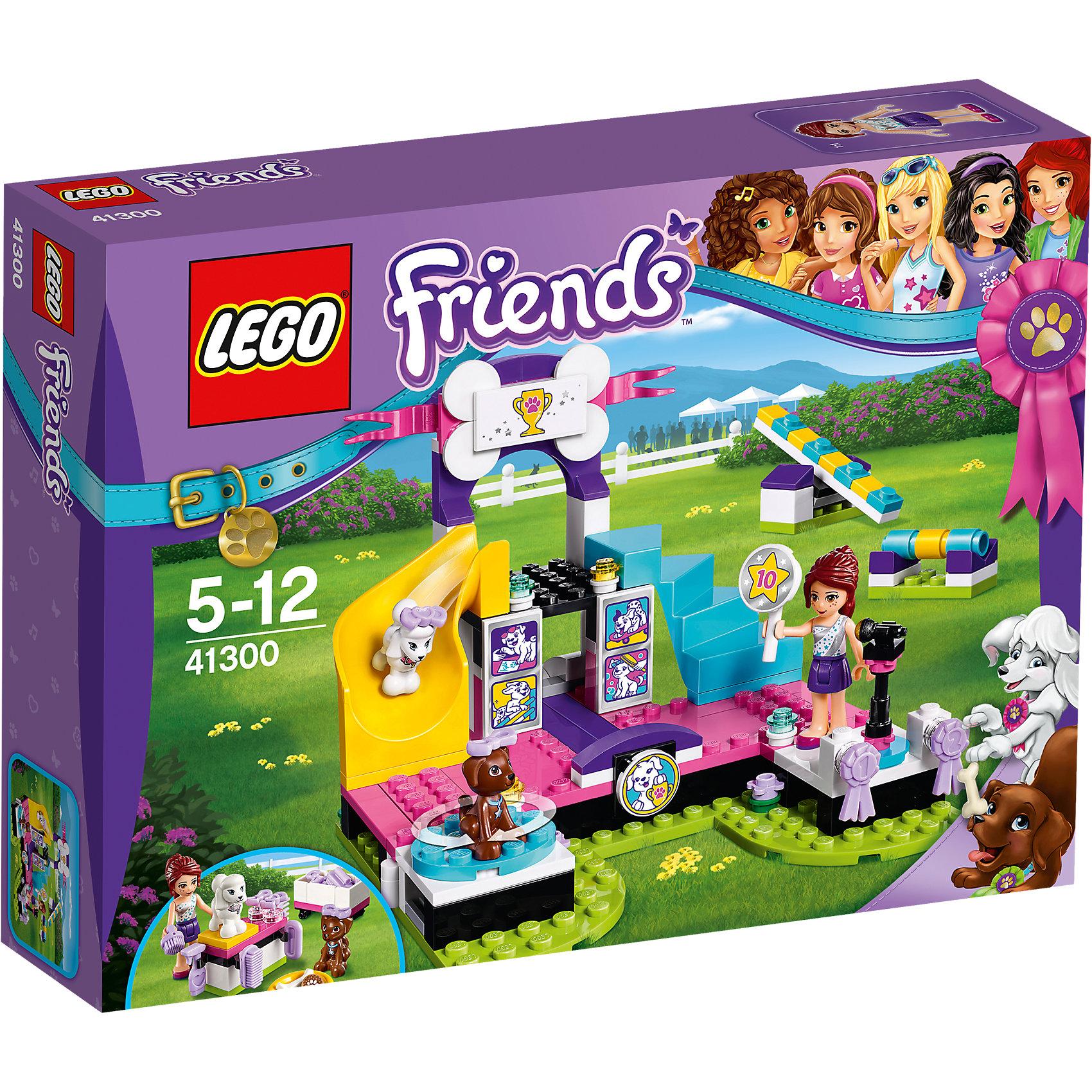 LEGO Friends 41300: Выставка щенков: ЧемпионатПластмассовые конструкторы<br>LEGO Friends 41300: Выставка щенков: Чемпионат<br><br>Характеристики:<br><br>- в набор входит: детали сцены и препятсвий для кросса, фигурка Мии, 2 щенка, аксессуары, красочная инструкция<br>- состав: пластик<br>- количество деталей: 185<br>- размер сцены: 16 * 10 * 13 см.<br>- для детей в возрасте: от 5 до 12 лет<br>- Страна производитель: Дания/Китай/Чехия<br><br>Легендарный конструктор LEGO (ЛЕГО) представляет серию «Friends» (Друзья) в которую входят наборы конструкторов интересных не только в строительстве, но и в игре. <br><br>Серия разработана с учетом различных повседневных ситуаций и мест. Присоединяйся к Мие и ее щенкам на выставке собак! Щенки начинают выставку проходя большие ворота, специальный выдвижной механизм перемещает фигурки вперед через ворота. На вращающемся столе жюри рассматривают породу животного и соответствие стандарту породы. Далее щенку предстоит преодолеть полосу препятствий в виде качелей и барьера со съемной планкой. Первый по красоте и ловкости щенок пройдет по ступеням славы и гордо спустится с горки победителем. Специальные призы вручаются и занявшему второе место щенку. Мия тщательно приводит щенков Тину и Скаута в порядок, в набор включены: стол для тримминга, небольшая раковина, все необходимые щетки и расчески, а также съемные бантики с которыми собачки будут выглядеть еще очаровательнее. <br><br>Сама фигурка Мии отлично проработана, ее рельефные волосы уложены в аккуратную прическу, а наряд отлично подходит для такой выставки – блестящий топ и простая фиолетовая юбочка. Фигурка может двигать головой, руками, торсом и принимать сидячее положение. Фигурки щенков вставляются в детали лего, чтобы они не падали, благодаря специальным отверстиям им можно надевать и снимать бантики. <br><br>Играя с конструктором ребенок развивает моторику рук, воображение и логическое мышление, научится собирать по инструкции и создавать свои модели. Придумывайте новые истори
