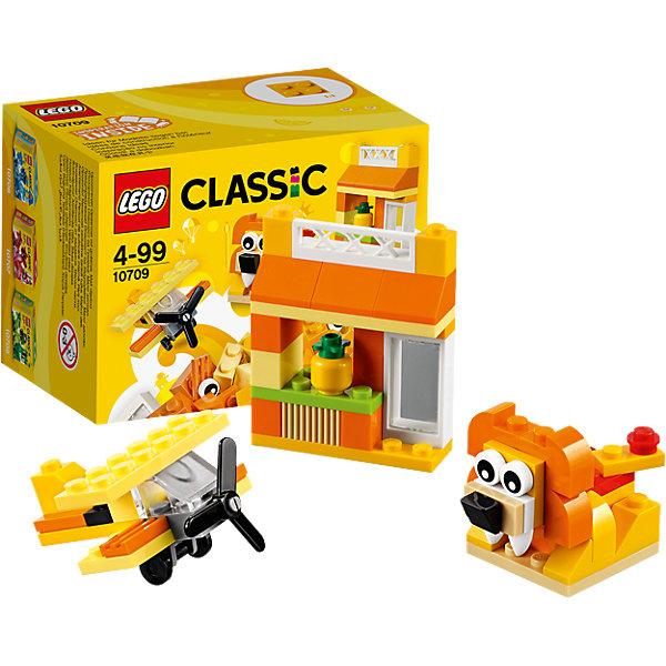 LEGO Classic 10709: Оранжевый набор для творчестваПластмассовые конструкторы<br>LEGO Classic 10709: Оранжевый набор для творчества<br><br>Характеристики:<br><br>- в набор входит: детали домика, самолета и льва, аксессуары, красочная инструкция<br>- состав: пластик<br>- количество деталей: 60 <br>- размер упаковки: 12 * 8 * 9 см.<br>- для детей в возрасте: от 4 лет<br>- Страна производитель: Дания/Китай/Чехия<br><br>Легендарный конструктор LEGO (ЛЕГО) представляет серию «Classic» (Классик), предназначенную для свободного конструирования. В наборы этой серии включены разнообразные детали, позволяющие строить в свое удовольствие и на свое усмотрение. Оранжевый набор для творчества включает в себя детали с колесиками, две детали глаз, прозрачную деталь ветрового стекла и стандартные детали. С помощью этого набора можно собрать по инструкции льва, дом и самолет, а также придумать свои транспортные средства, своих животных и свой домик. В оранжевом наборе представлено пять оттенков оранжевого, а также белые, серые, черные и зеленые детали. Красочна инструкция предлагает варианты комбинирования наборов и новые интересные постройки. Играя с конструктором ребенок развивает моторику рук, воображение и логическое мышление. Воплотите в жизнь свои идеи с помощью набора LEGO «Classic»!<br><br>Конструктор LEGO Classic 10709: Оранжевый набор для творчества можно купить в нашем интернет-магазине.<br>Ширина мм: 122; Глубина мм: 90; Высота мм: 79; Вес г: 91; Возраст от месяцев: 48; Возраст до месяцев: 144; Пол: Унисекс; Возраст: Детский; SKU: 5002502;