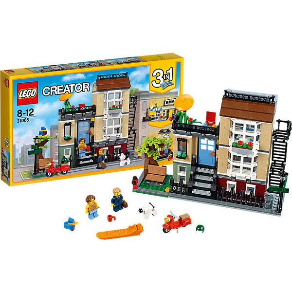 LEGO Creator 31065: Домик в пригородеКонструкторы Лего<br>LEGO Creator 31065: Домик в пригороде<br><br>Характеристики:<br><br>- в набор входит: детали для дома, 2 минифигурки, аксессуары, красочная инструкция<br>- состав: пластик<br>- количество деталей: 566<br>- размер таунхауса: 24 * 7 * 20 см.<br>- размер городского кафе: 24 * 8 * 11 см.<br>- размер пригородного дома: 16 * 12 * 16 см.<br>- для детей в возрасте: от 7 до 12 лет<br>- Страна производитель: Дания/Китай/Чехия<br><br>Легендарный конструктор LEGO (ЛЕГО) представляет серию «Creator» (Криэйтор), которая позволяет детям экспериментировать с домами, машинами, самолетами и существами. Каждый набор этой серии подразумевает перестройку тремя разными способами убирая ограничения веселья! Набор Домик в пригороде придет по вкусу строителям зданий и любителям городских пейзажей. Большой трехэтажный таунхаус, расположенный в самом центре города возле небольшого парка, удобно закрывается. Этажи дома выполнены в разных цветах, а внутри дома имеется необходимая мебель. Первый этаж оборудован под гостиную с камином, диванчиком и большим телевизором, второй этаж оборудован под кухню и через него можно войти через открывающуюся дверь. На третьем этаже расположена спальня с большой кроватью и выходом на крышу, где стоит небольшой столик, стульчик и зонтик от солнца. При закрытии домика спальная комната закрывается деталью-стеклом, отгораживающей уличное пространство крыши и оставляя превосходный вид из окна для героев. Таунхаус можно перестроить в пригородное кафе с изящными арками и колоннами. Кафе окружено цветами и имеет неповторимую атмосферу спокойствия. Или можно построить из деталей набора пригородный домик с оранжереей и благоухающими цветами. Цвета деталей ЛЕГО отлично подобраны и они формируют прекрасные здания с разделением этажей по цветам. Уникальные детали окон позволяют строить окна разных стилей, а также оранжереи. Минифигурки набора выполнены очень качественно и отлично прорисованы. В набор входит скутер с