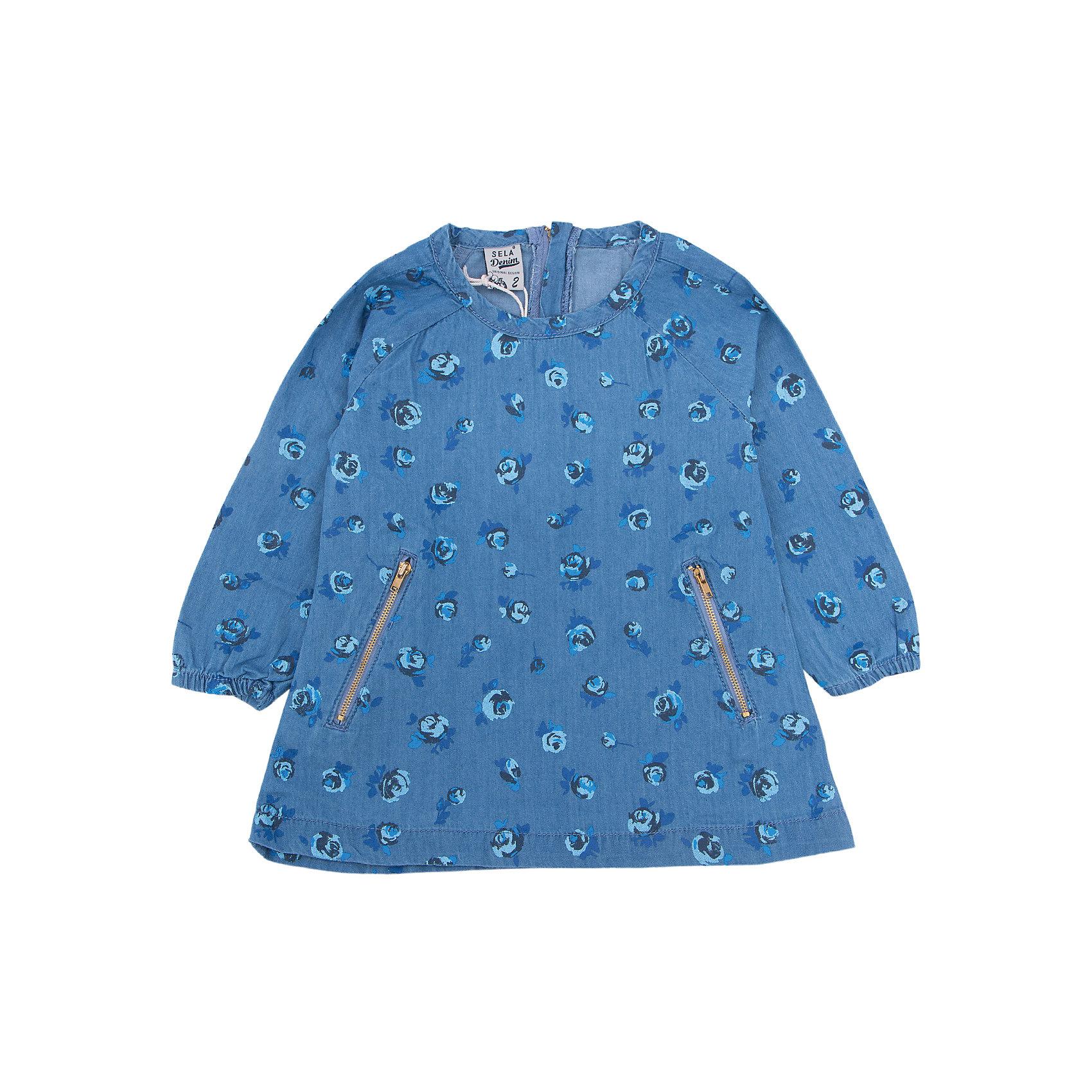 Платье для девочки SELAПлатье с принтом - очень модная вещь. Эта модель отлично сидит на ребенке, она смотрится стильно и нарядно. Приятная на ощупь ткань и качественная фурнитура обеспечивает ребенку комфорт. Модель станет отличной базовой вещью, которая будет уместна в различных сочетаниях.<br>Одежда от бренда Sela (Села) - это качество по приемлемым ценам. Многие российские родители уже оценили преимущества продукции этой компании и всё чаще приобретают одежду и аксессуары Sela.<br><br>Дополнительная информация:<br><br>цвет: синий;<br>материал: 100% хлопок;<br>с принтом;<br>длинный рукав.<br><br>Платье для девочки от бренда Sela можно купить в нашем интернет-магазине.<br><br>Ширина мм: 236<br>Глубина мм: 16<br>Высота мм: 184<br>Вес г: 177<br>Цвет: синий<br>Возраст от месяцев: 18<br>Возраст до месяцев: 24<br>Пол: Женский<br>Возраст: Детский<br>Размер: 116,110,104,98,92<br>SKU: 5020135