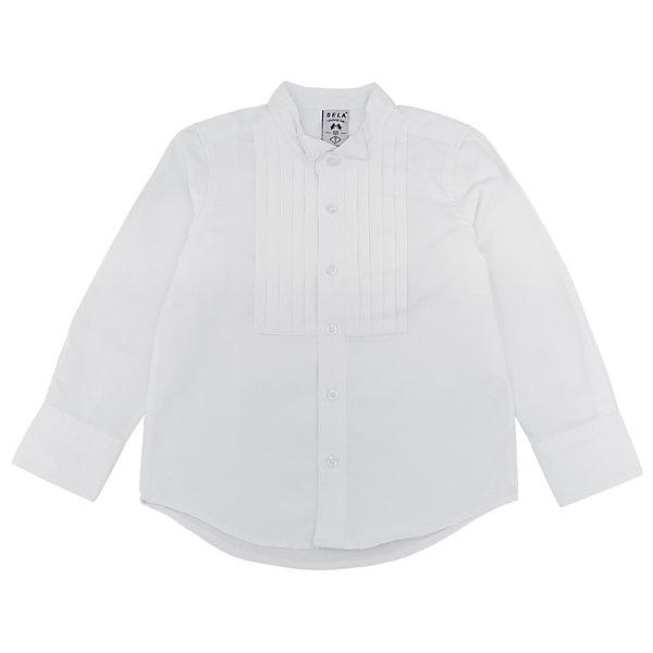 Рубашка для мальчика SELAБлузки и рубашки<br>Рубашка для мальчика SELA<br><br>Характеристики:<br><br>• Цвет белый.<br>• Рукав длинный.<br>• Силуэт прямой.<br>• Состав:50% хлопок, 50 %полиэстер.<br><br>Рубашка для мальчика SELA от признанного лидера по созданию коллекций одежды в стиле casual – SELA.<br>Данная модель из коллекции нового сезона, смотрится очень стильно. Полочки рубашки декорированы защипами. У данной модели необычный крой воротника. Натуральный хлопок в составе материала обеспечит коже возможность дышать и не вызовет аллергии.. Интересно смотрится благодаря комбинированию разных тканей. Изделие сшито из тщательно подобранных материалов, абсолютно безопасных для ребенка.<br><br>Рубашку для мальчика от компании SELA можно купить в нашем магазине.<br>Ширина мм: 174; Глубина мм: 10; Высота мм: 169; Вес г: 157; Цвет: белый; Возраст от месяцев: 60; Возраст до месяцев: 72; Пол: Мужской; Возраст: Детский; Размер: 116,98,92,104,110; SKU: 5020155;