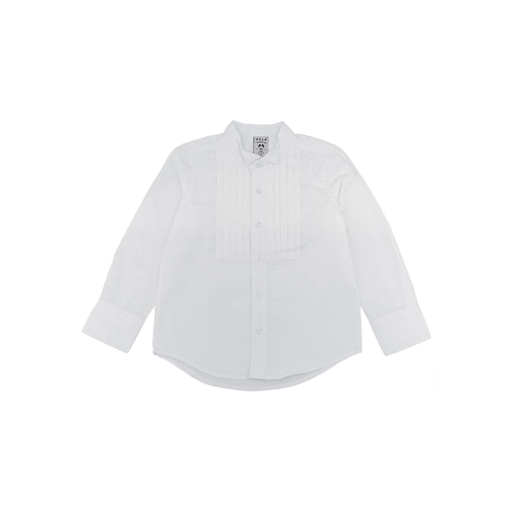 Рубашка для мальчика SELAРубашка для мальчика SELA<br><br>Характеристики:<br><br>• Цвет белый.<br>• Рукав длинный.<br>• Силуэт прямой.<br>• Состав:50% хлопок, 50 %полиэстер.<br><br>Рубашка для мальчика SELA от признанного лидера по созданию коллекций одежды в стиле casual – SELA.<br>Данная модель из коллекции нового сезона, смотрится очень стильно. Полочки рубашки декорированы защипами. У данной модели необычный крой воротника. Натуральный хлопок в составе материала обеспечит коже возможность дышать и не вызовет аллергии.. Интересно смотрится благодаря комбинированию разных тканей. Изделие сшито из тщательно подобранных материалов, абсолютно безопасных для ребенка.<br><br>Рубашку для мальчика от компании SELA можно купить в нашем магазине.<br><br>Ширина мм: 174<br>Глубина мм: 10<br>Высота мм: 169<br>Вес г: 157<br>Цвет: белый<br>Возраст от месяцев: 60<br>Возраст до месяцев: 72<br>Пол: Мужской<br>Возраст: Детский<br>Размер: 92,110,104,98,116<br>SKU: 5020155
