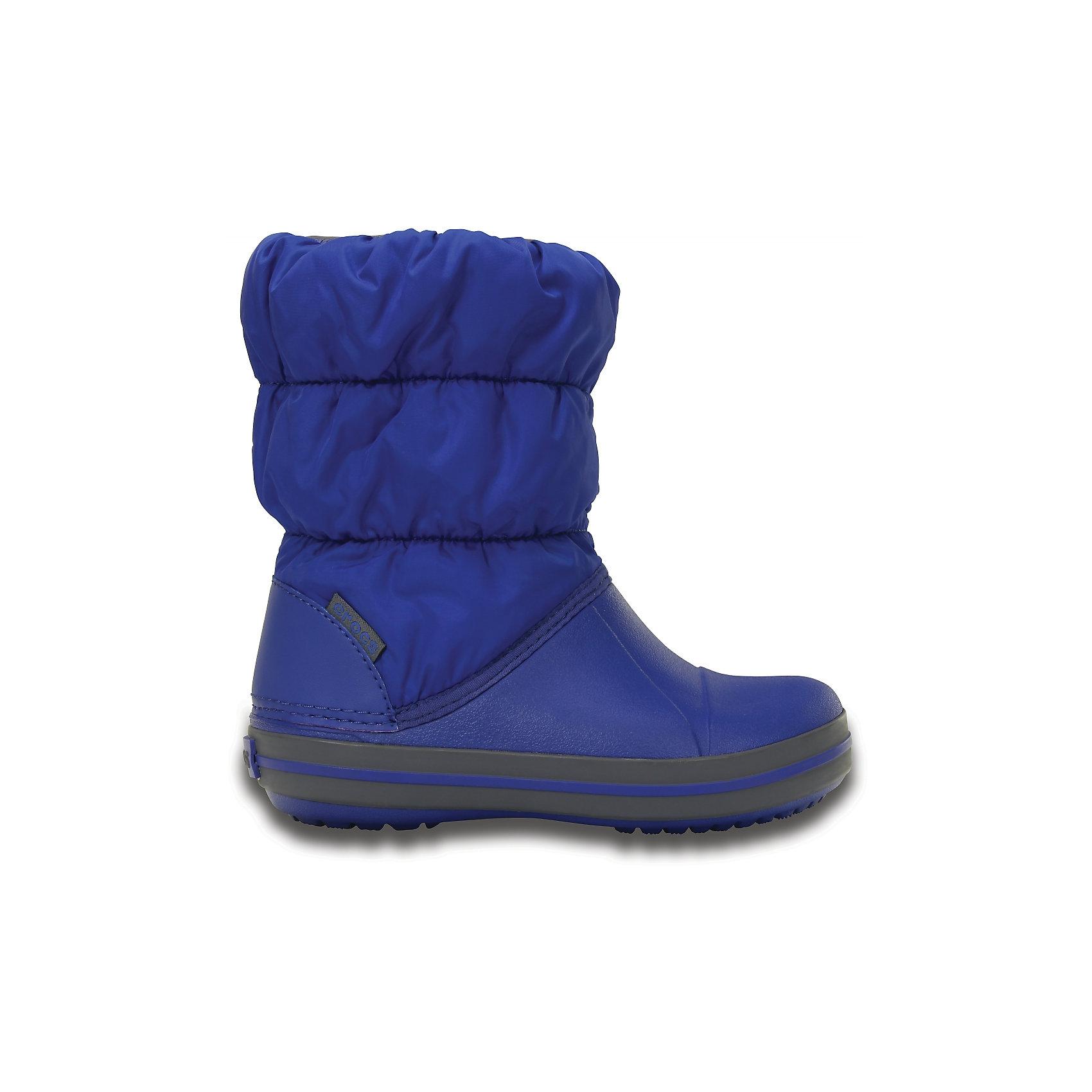 Сапоги Winter Puff для мальчика CROCSХарактеристики товара:<br><br>• цвет: синий<br>• материал: верх - текстиль, низ -100% полимер Croslite™<br>• материал подкладки: текстиль<br>• непромокаемая носочная часть<br>• температурный режим: от -15° до +10° С<br>• легко очищаются<br>• антискользящая подошва<br>• резинка наверху<br>• толстая устойчивая подошва<br>• страна бренда: США<br>• страна изготовитель: Китай<br><br>Сапоги могут быть и стильными, и теплыми! Для детской обуви крайне важно, чтобы она была удобной. Такие сапоги обеспечивают детям необходимый комфорт, а теплая подкладка создает особый микроклимат. Сапоги легко надеваются и снимаются, отлично сидят на ноге. Материал, из которого они сделаны, не дает размножаться бактериям, поэтому такая обувь препятствует образованию неприятного запаха и появлению болезней стоп. Данная модель особенно понравится детям - ведь в них можно бегать по лужам!<br>Обувь от американского бренда Crocs в данный момент завоевала широкую популярность во всем мире, и это не удивительно - ведь она невероятно удобна. Её носят врачи, спортсмены, звёзды шоу-бизнеса, люди, которым много времени приходится бывать на ногах - они понимают, как важна комфортная обувь. Продукция Crocs - это качественные товары, созданные с применением новейших технологий. Обувь отличается стильным дизайном и продуманной конструкцией. Изделие производится из качественных и проверенных материалов, которые безопасны для детей.<br><br>Сапоги для мальчика от торговой марки Crocs можно купить в нашем интернет-магазине.<br><br>Ширина мм: 257<br>Глубина мм: 180<br>Высота мм: 130<br>Вес г: 420<br>Цвет: синий<br>Возраст от месяцев: 36<br>Возраст до месяцев: 48<br>Пол: Мужской<br>Возраст: Детский<br>Размер: 27,34/35,28,29,30,23,24,25,26,31/32,33/34<br>SKU: 5027469