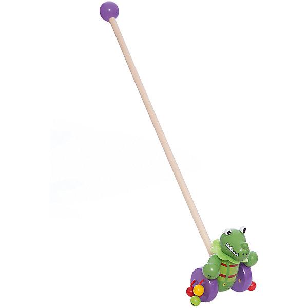 Каталка Динозаврик, MapachaДеревянные игрушки<br>Каталки – интересные игрушки, которые любят все малыши. Данная модель выполнена из пластика, представлена в виде динозаврика. Внизу у игрушки есть колесики, которые легко передвигаются по любым поверхностям. Каталка – игрушка на длинной ручке. Малыш держит игрушку за ручку и катит впереди или позади себя. Благодаря колесикам ребенок не устает носить с собой каталку. Яркие цвета, стильный дизайн – достоинства новой модели. Материалы, использованные при изготовлении товара, абсолютно безопасны и отвечают всем международным требованиям по качеству.<br><br>Дополнительные характеристики:<br><br>материал: пластик, ПВХ;<br>цвет: разноцветный;<br>габариты: 36 X 18 X 23 см.<br><br>Каталку Динозаврик от компании Mapacha можно приобрести в нашем магазине.<br><br>Ширина мм: 515<br>Глубина мм: 350<br>Высота мм: 260<br>Вес г: 271<br>Возраст от месяцев: 12<br>Возраст до месяцев: 36<br>Пол: Унисекс<br>Возраст: Детский<br>SKU: 5032495