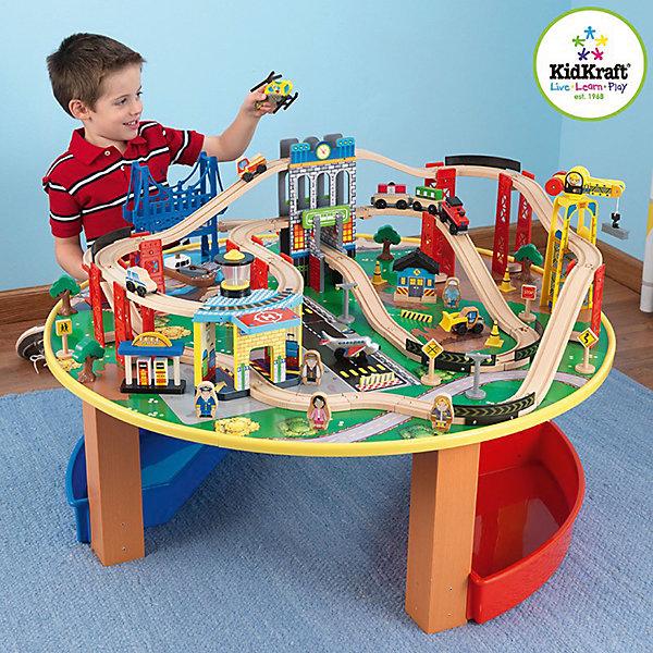 Деревянная железная дорога Наш город, 80 элементов со столом, KidKraftЖелезные дороги<br>Деревянная железная дорога Наш город, 80 элементов со столом, KidKraft (КидКрафт).<br><br>Характеристики:<br><br>? Материалы: дерево, пластик, резина, текстиль.<br>? 80 игровых элементов.<br>? Размеры игрушки: 102x102x39 см<br>? Размер упаковки: 61 ? 110 ? 18 см.<br>? Вес: 20 кг<br><br>Железная дорога со столом «Наш город» KidKraft - уникальная многоуровневая магистраль, проходящая через большой город. Игровая поверхность располагается на удобном круглом столе, что делает ее легкодоступной нескольким игрокам. В ходе игры дети узнают о городских профессиях, о назначении зданий в городе, а так же о пассажирском, грузовом и специальном транспорте. Железная дорога изготовлена из натурального дерева, все элементы идеально проработаны. Яркие, красочные элементы безусловно привлекут внимание Вашего малыша! Очень устойчивая конструкция, выступающие края стола обработаны специальной резиной во избежание повреждений у ребенка. Два пластиковых ящика позволят поддерживать порядок в игровой зоне. <br>Удивите и порадуйте своего малыша, подарив ему железную дорогу со столом «Наш город» KidKraft!<br><br>Деревянную железную дорогу Наш город, 80 элементов со столом, KidKraft (КидКрафт), можно купить в нашем интернет – магазине.<br><br>Ширина мм: 110<br>Глубина мм: 610<br>Высота мм: 180<br>Вес г: 20000<br>Возраст от месяцев: 36<br>Возраст до месяцев: 120<br>Пол: Унисекс<br>Возраст: Детский<br>SKU: 5044999