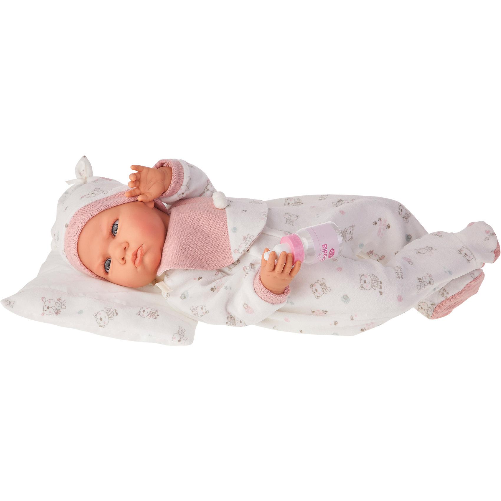 Кукла Бертина в розовом, озвученная, 52 см, Munecas Antonio JuanКлассические куклы<br>Кукла Бертина в розовом, озвученная, 52 см, Munecas Antonio Juan (Мунекас Антонио Хуан).<br><br>Характеристики:<br><br>- Комплектация: кукла в одежде, бутылочка, подушка<br>- Материал: винил, текстиль<br>- Высота куклы: 52 см.<br>- Глаза не закрываются<br>- Интерактивные функции куклы: нажмите на животик 1 раз и кукла начнет по детски лепетать<br>- Батарейки: 3 x AG13 / LR44 (входят в комплект)<br>- Упаковка: яркая подарочная коробка<br><br>Малышка Бертина невероятно похожа на настоящего младенца, совпадает даже рост (52 см). Анатомическая точность, с которой выполнена кукла, поражает! Голубые глазки, маленький носик, нежные щечки, улыбка, милые «перевязочки» на ручках и ножках придают кукле реалистичный вид и вызывают только самые положительные и добрые эмоции. Бертина одета в белый комбинезон с рисунком в виде зверушек и розовой манишкой на груди, на голове - теплая мягкая шапочка с декоративными завязочками. Одежда дополнена розовыми вязанными манжетами. В комплекте также предусмотрена бутылочка и мягкая подушечка, на которую куклу можно удобно разместить. Кукла оснащена звуковым модулем, если нажать на животик, Бертина начнет реалистично агукать, как новорождённый ребенок. Тельце у куклы мягко-набивное, голова, ручки и ножки сделаны из высококачественного винила. Голова, ручки и ножки подвижны. Кукла изготовлена из высококачественных и экологически чистых материалов, поэтому безопасна для детей любого возраста, соответствует всем нормам и требованиям к качеству детских товаров. Образы малышей Мунекас разработаны известными европейскими дизайнерами. Они натуралистичны, анатомически точны.<br><br>Куклу Бертина в розовом, озвученную, 52 см, Munecas Antonio Juan (Мунекас Антонио Хуан) можно купить в нашем интернет-магазине.<br><br>Ширина мм: 59<br>Глубина мм: 29<br>Высота мм: 14<br>Вес г: 1825<br>Возраст от месяцев: 36<br>Возраст до месяцев: 2147483647<br>Пол: Женский<br>Возраст: Д