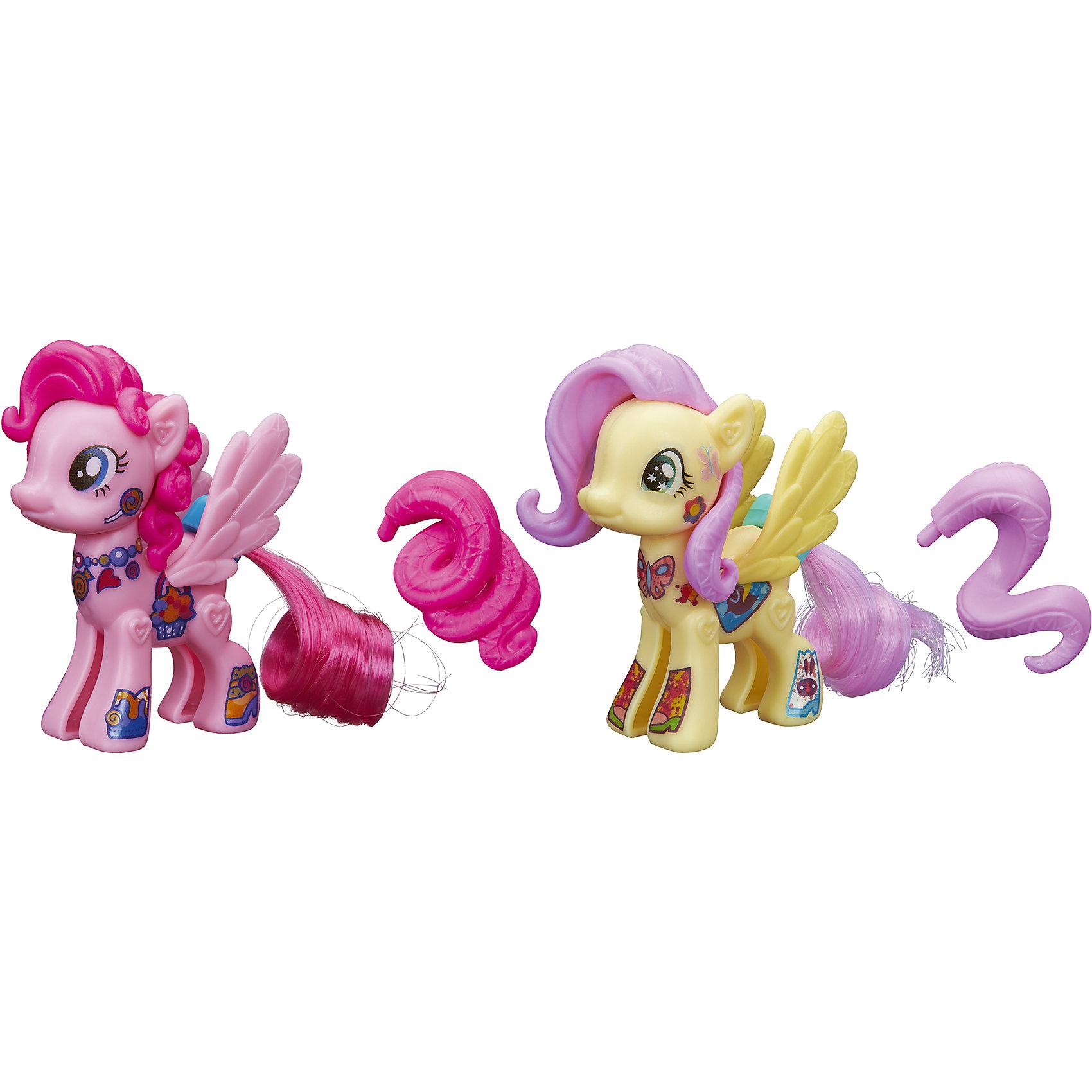 Флаттершай и Пинки Пай, стильные пони Создай свою пони, My little Pony, B3589/B4970Стильные пони Создай свою пони, My little Pony, B3589/B4970.<br><br>Характеристики:<br><br>- В наборе: две фигурки пони (каждая из двух половинок) Флаттершай и Пинки Пай, две пары красивых резных крыльев, две пряди, две пластмассовые гривы, два пластмассовых хвоста, наклейки<br>- Можно комбинировать с другими наборами серии<br>- Материал: высококачественная пластмасса<br>- Размер упаковки: 21x14x2,5 см.<br><br>Игровой набор Создай свою пони станет приятным подарком для девочки - поклонницы мультсериала Моя маленькая пони. Дружба - это чудо!. Малышка сможет самостоятельно соединить две части пони вместе и создать неповторимый образ для Флаттершай и Пинки Пай, подобрав гриву, хвостик и крылышки для своих любимиц. Игрушки выполнены из высококачественной пластмассы и имеют поразительное сходство с героями мультсериала. Игровой набор позволит придумать множество разных сюжетных линий, историй и развить фантазию и мелкую моторику. Фигурки отлично впишутся в коллекцию девочки и подарят ей множество положительных эмоций. Детали набора можно комбинировать с элементами из других наборов Создай свою пони.<br><br>Набор Стильные пони Создай свою пони, My little Pony, B3589/B4970 можно купить в нашем интернет-магазине.<br><br>Ширина мм: 25<br>Глубина мм: 140<br>Высота мм: 490<br>Вес г: 180<br>Возраст от месяцев: 48<br>Возраст до месяцев: 144<br>Пол: Женский<br>Возраст: Детский<br>SKU: 5064680