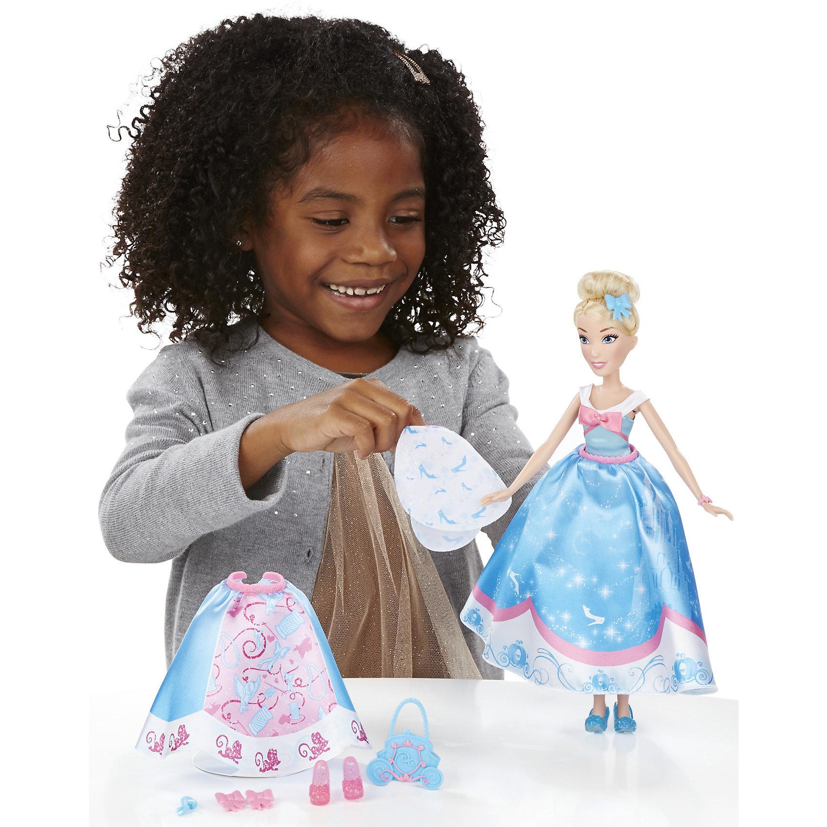 Кукла Золушка в  платье со сменными юбками, Принцессы Дисней, B5312/B5314Кукла Золушка в платье со сменными юбками, Принцессы Дисней, B5312/B5314.<br><br>Характеристики:<br><br>- В наборе: кукла; 3 текстильные юбки, которые можно прикреплять к платью; 4 клипсы в виде бантов и цветов для украшения наряда; ободок, сумочка, дополнительная пара туфель<br>- Высота куклы: 28 см.<br>- Материал: высококачественный пластик, текстиль<br>- Размер упаковки: 16,5х6,4х35,6 см.<br>- Вес упаковки: 197 г.<br><br>Очаровательная кукла в виде Золушки, героини одноименного мультфильма от торговой марки Hasbro (Хасбро) станет любимой игрушкой вашей маленькой принцессы. Она изготовлена из прочного пластика, а ее одежда пошита из высококачественного текстиля. Кукла имеет высокую степень детализации, даже самые мелкие детали качественно прорисованы. Золушка одета в нежно-голубое платье и носит красивую сумочку. Локоны принцессы собраны в элегантный пучок. Дополнительные юбки, украшения и туфли, входящие в комплект, разнообразят гардероб Золушки. Девочка сможет сочетать различные юбки и декорировать наряд куклы аксессуарами, чтобы создать неповторимый наряд для принцессы. С замечательной куклой ваша малышка окунется в сказочный мир, и будет придумывать увлекательные истории про любимую героиню.<br><br>Куклу Золушка в платье со сменными юбками, Принцессы Дисней, B5312/B5314 можно купить в нашем интернет-магазине.<br><br>Ширина мм: 64<br>Глубина мм: 165<br>Высота мм: 356<br>Вес г: 197<br>Возраст от месяцев: 36<br>Возраст до месяцев: 144<br>Пол: Женский<br>Возраст: Детский<br>SKU: 5064703