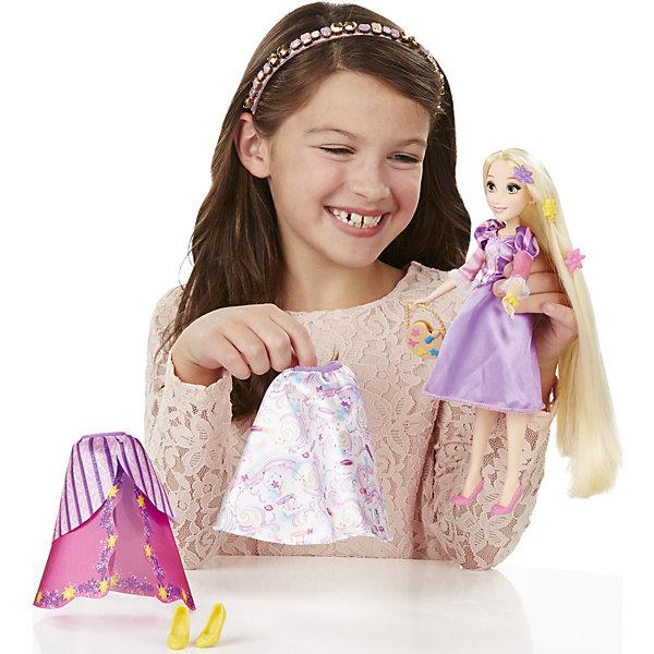 Кукла Рапунцель в  платье со сменными юбками, Принцессы Дисней, B5312/B5315Игрушки<br>Кукла Рапунцель в платье со сменными юбками, Принцессы Дисней, B5312/B5315.<br><br>Характеристики:<br><br>- В наборе: кукла; 3 текстильные юбки, которые можно прикреплять к платью; 4 клипсы в виде бантов и цветов для украшения наряда; ободок, сумочка, дополнительная пара туфель<br>- Высота куклы: 28 см.<br>- Материал: высококачественный пластик, текстиль<br>- Размер упаковки: 16,5х6,4х35,6 см.<br>- Вес упаковки: 197 г.<br><br>Очаровательная кукла в виде Рапунцель, героини одноименного мультфильма от торговой марки Hasbro (Хасбро) станет любимой игрушкой вашей маленькой принцессы. Она изготовлена из прочного пластика, а ее одежда пошита из высококачественного текстиля. Кукла имеет высокую степень детализации, даже самые мелкие детали качественно прорисованы. Рапунцель одета в красивое розовое платье и носит бежевую сумочку. Туфельки желтого цвета отлично сочетаются с общим нарядом. Белокурые локоны принцессы можно расчесывать. Дополнительные юбки, украшения и туфли, входящие в комплект, разнообразят гардероб Рапунцель. Девочка сможет сочетать различные юбки и декорировать наряд куклы аксессуарами, чтобы создать неповторимый наряд для принцессы. С замечательной куклой ваша малышка окунется в сказочный мир, и будет придумывать увлекательные истории про любимую героиню.<br><br>Куклу Рапунцель в платье со сменными юбками, Принцессы Дисней, B5312/B5315 можно купить в нашем интернет-магазине.<br>Ширина мм: 64; Глубина мм: 165; Высота мм: 356; Вес г: 197; Возраст от месяцев: 36; Возраст до месяцев: 144; Пол: Женский; Возраст: Детский; SKU: 5064704;
